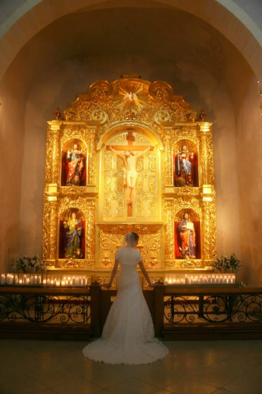 bridal photo in front of gold altar piece