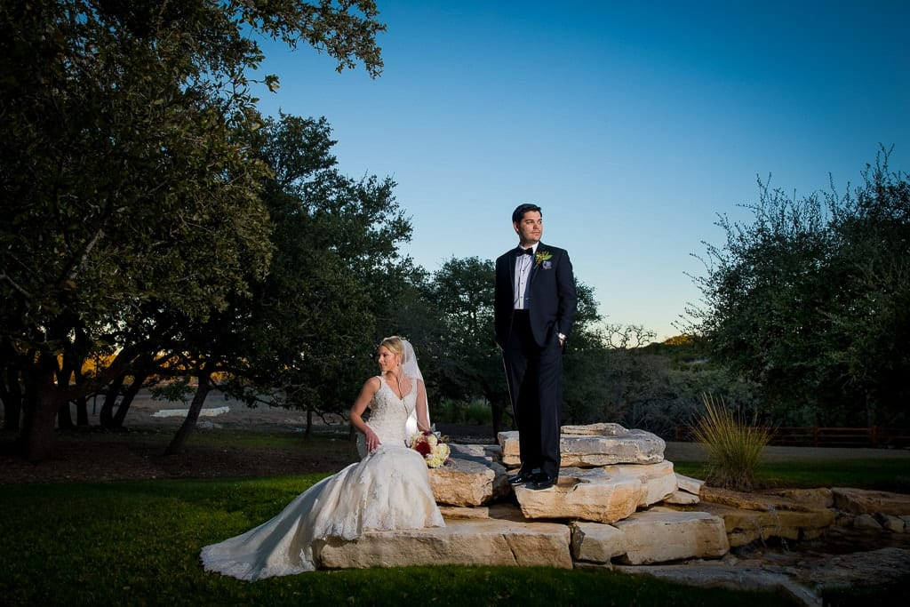 wedding photos on top of rock and greenery