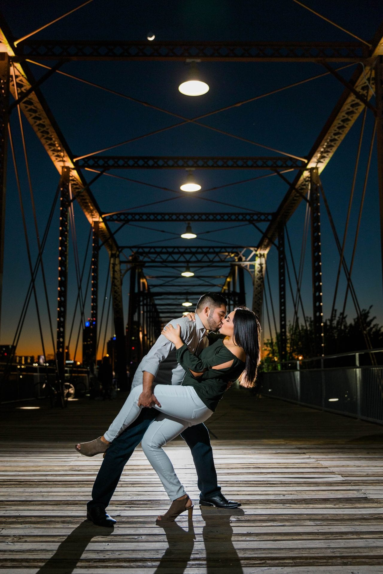 engagement photo in front of bridge