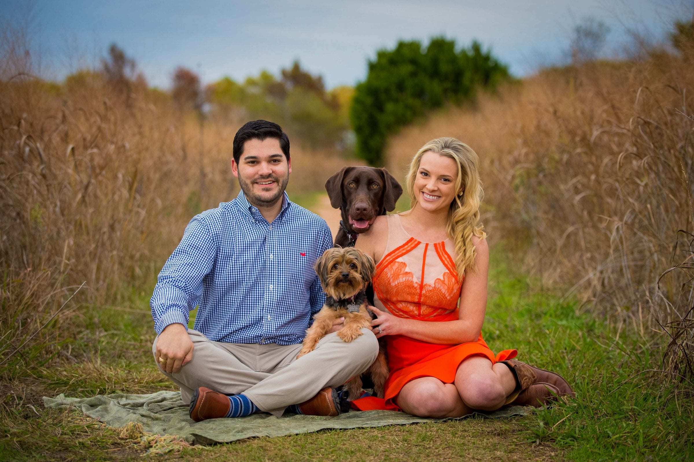 engagement photo with 2 dogs