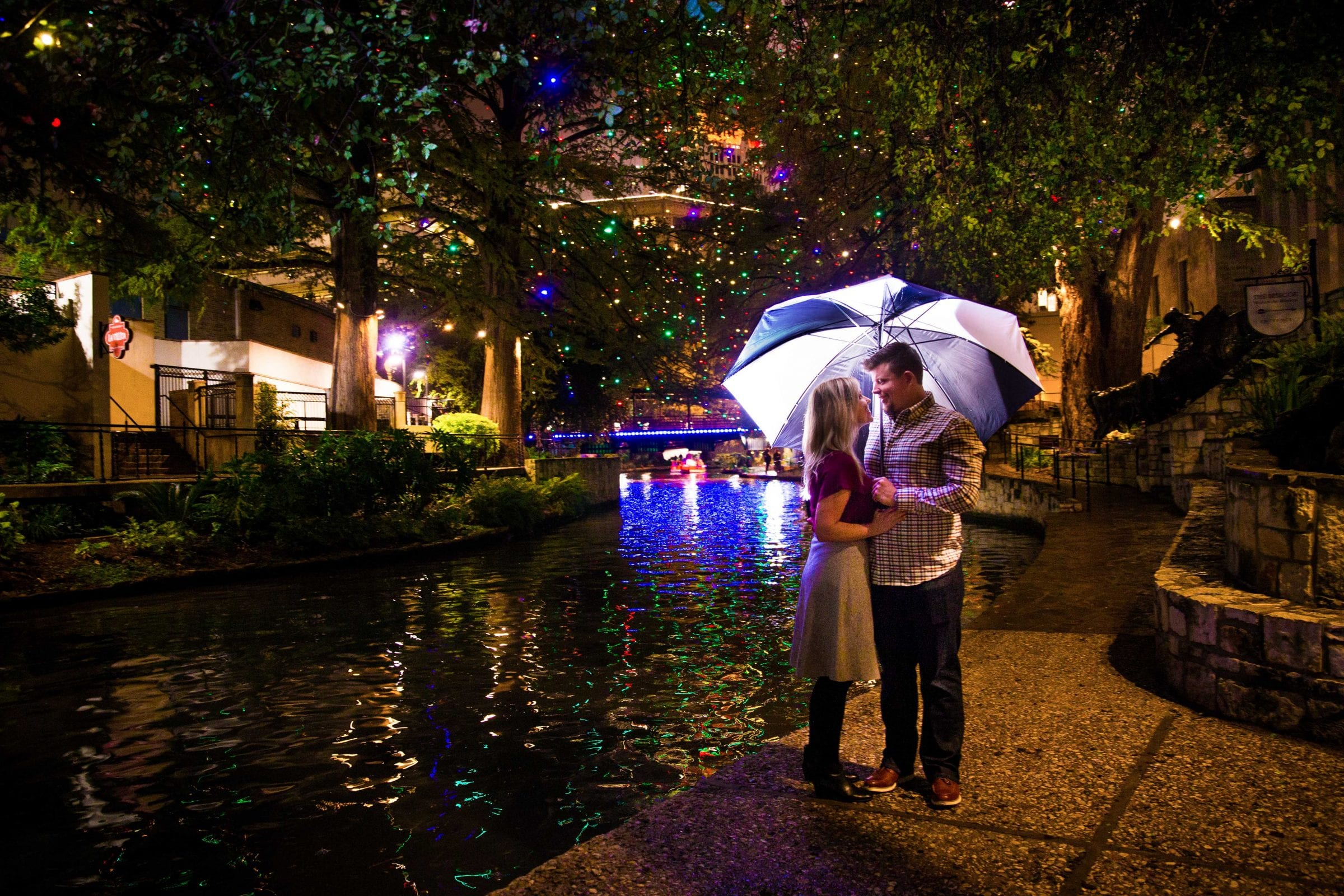 proposal photo under an umbrella downtown
