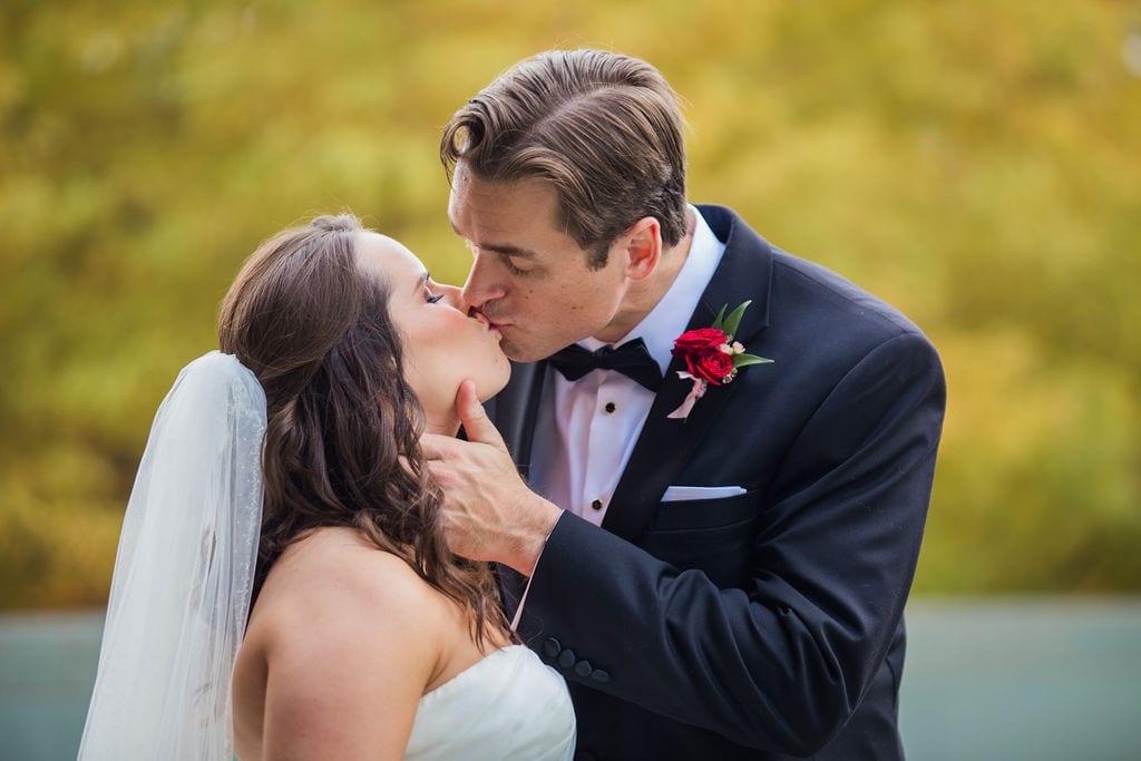 Ashley and Josh's wedding the McNay fall kiss