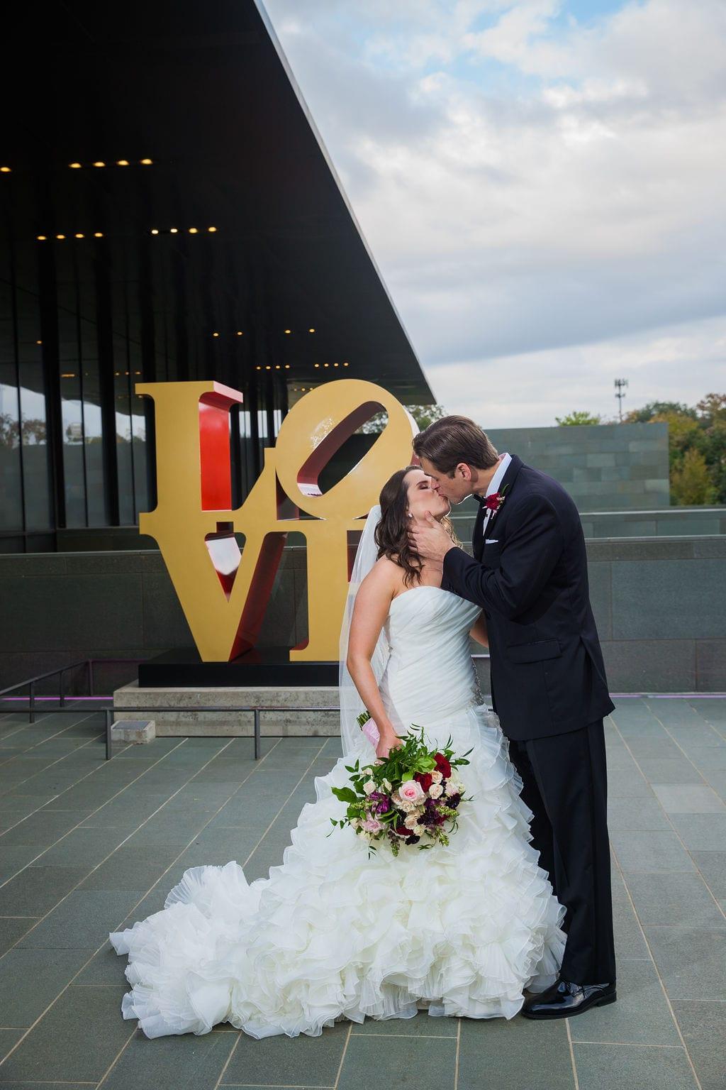 Ashley and Josh's wedding the McNay love sign kiss