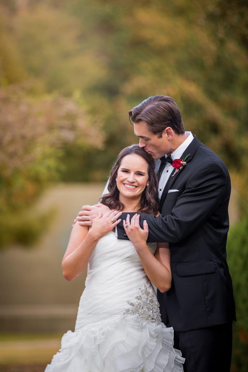Ashley and Josh's wedding the McNay fall branches hug