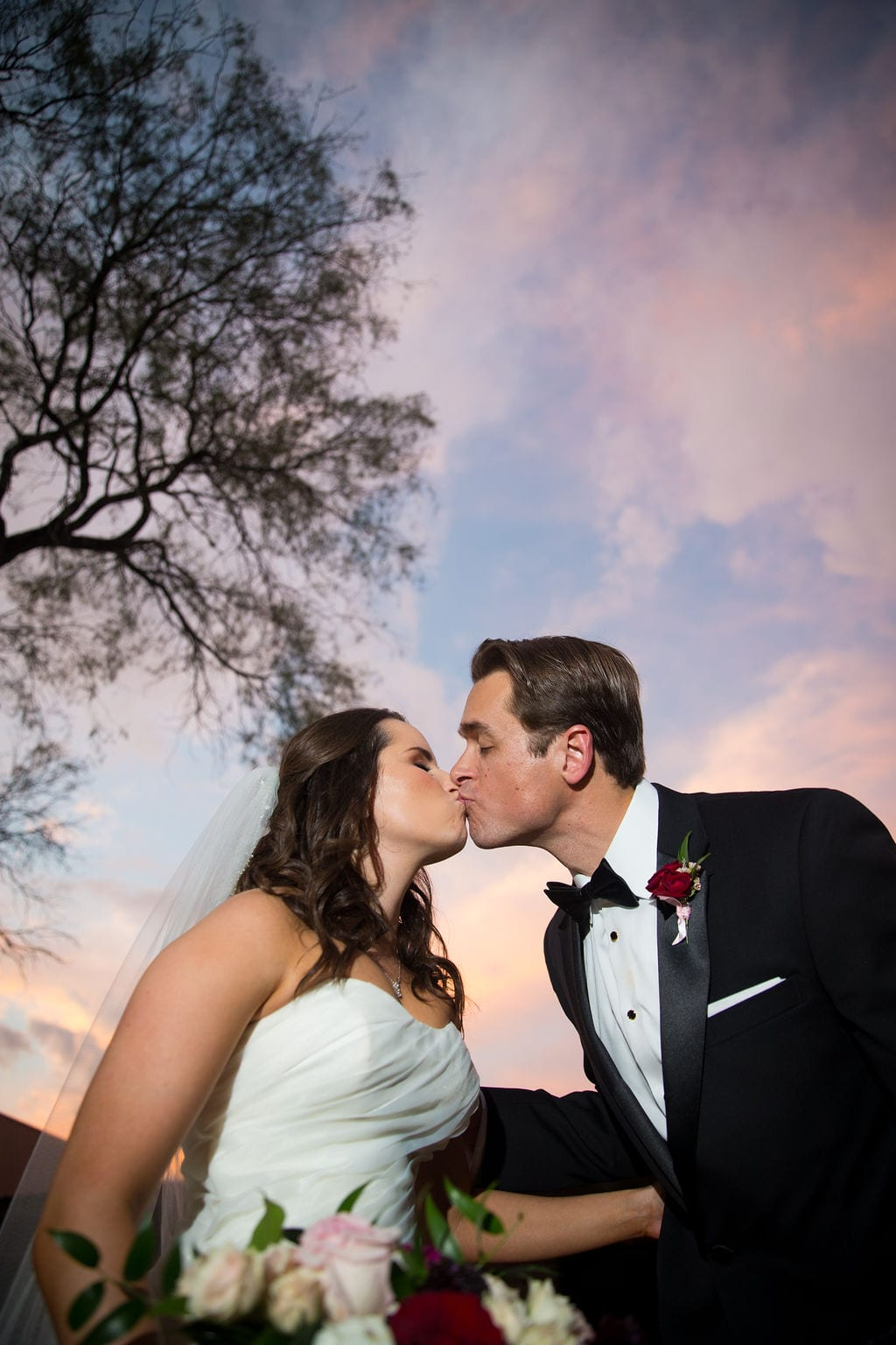 Ashley and Josh's wedding sunset kiss