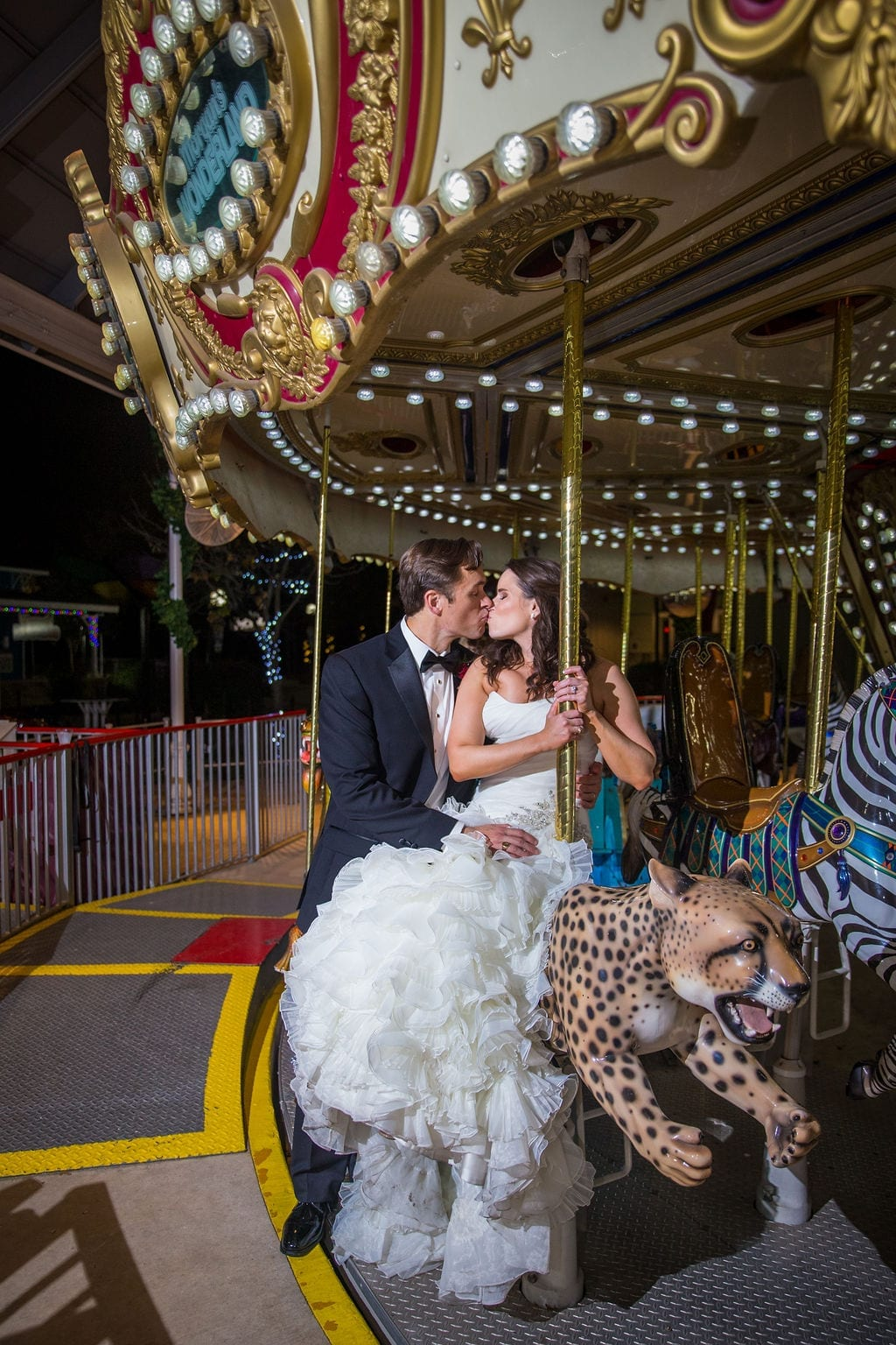 Ashley - Josh's wedding at Morgan's Wonderland on the carousel