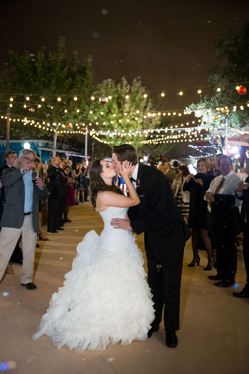 Ashley - Josh's wedding carousel exit kiss