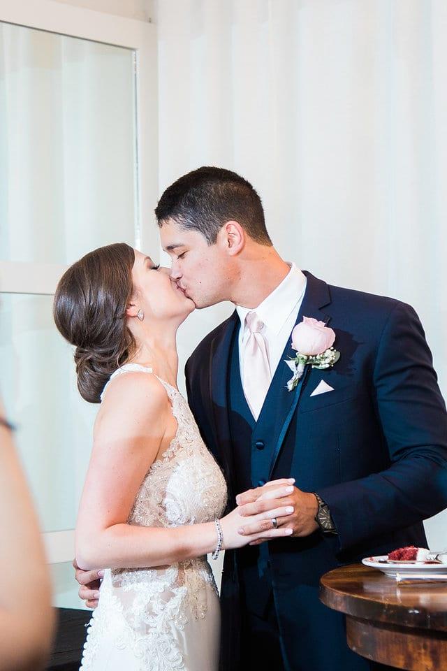 Samantha Wedding Hidden Falls cake kiss