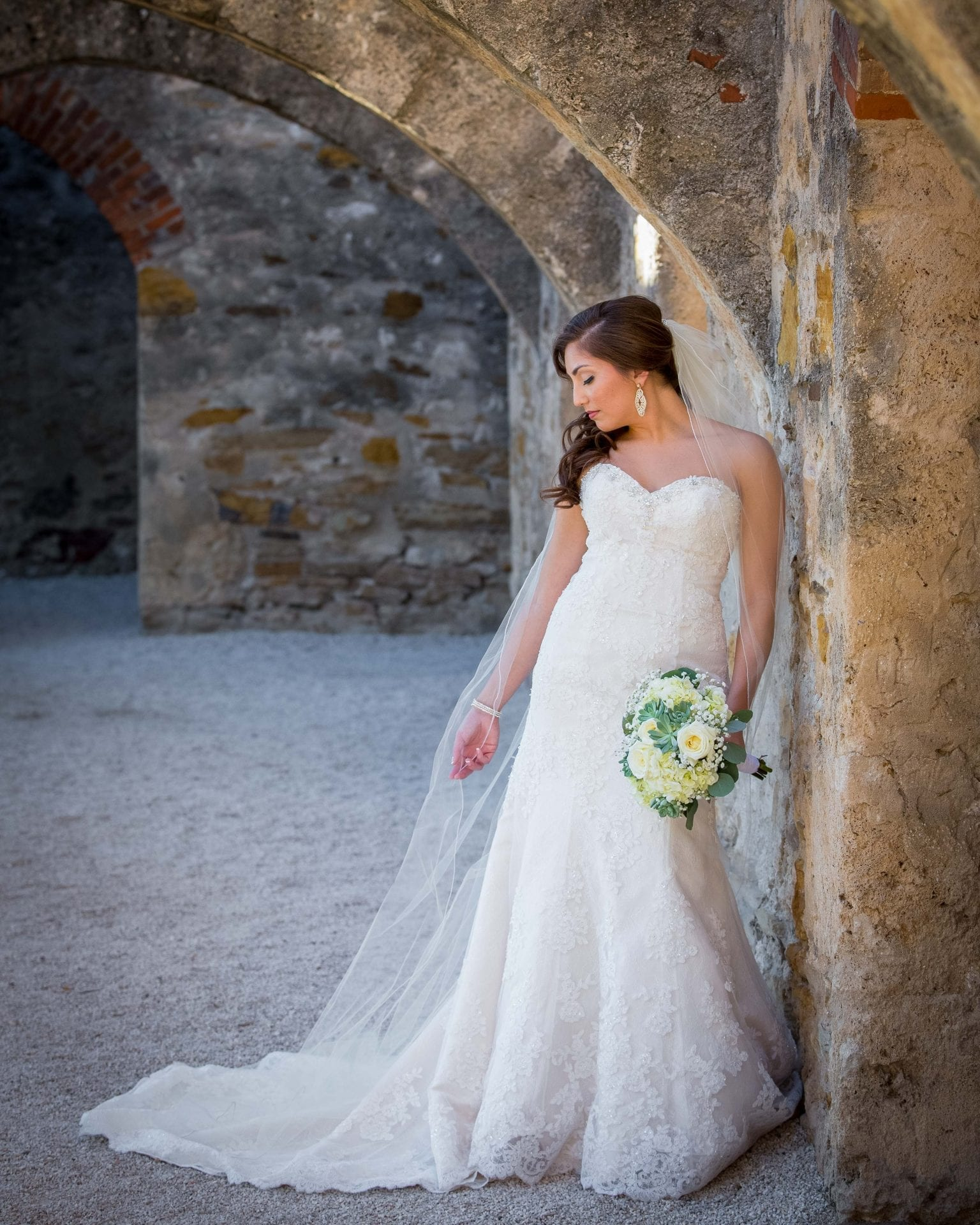 Alison Bridal at Mission san Jose in arch