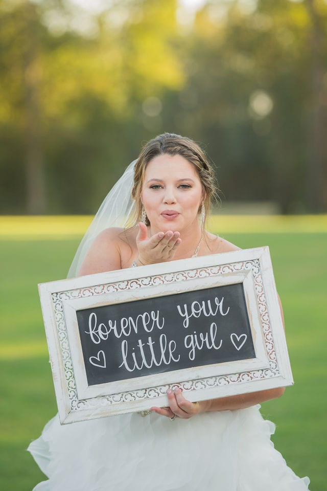 KJernigan Bridal Portrait Broad slab Distillery blow kiss