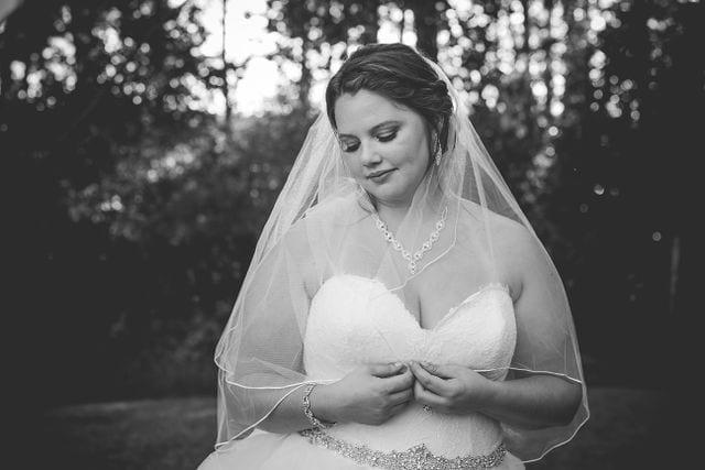 KJernigan Bridal Portrait Broad slab Distillery forrest