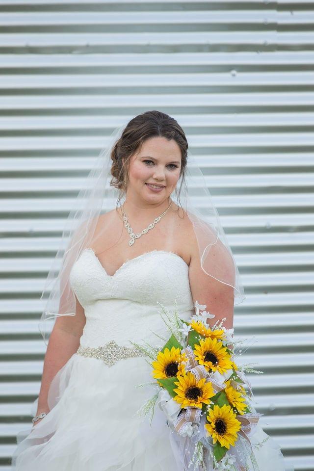 KJernigan Bridal Portrait Broad slab Distillery silo headshot