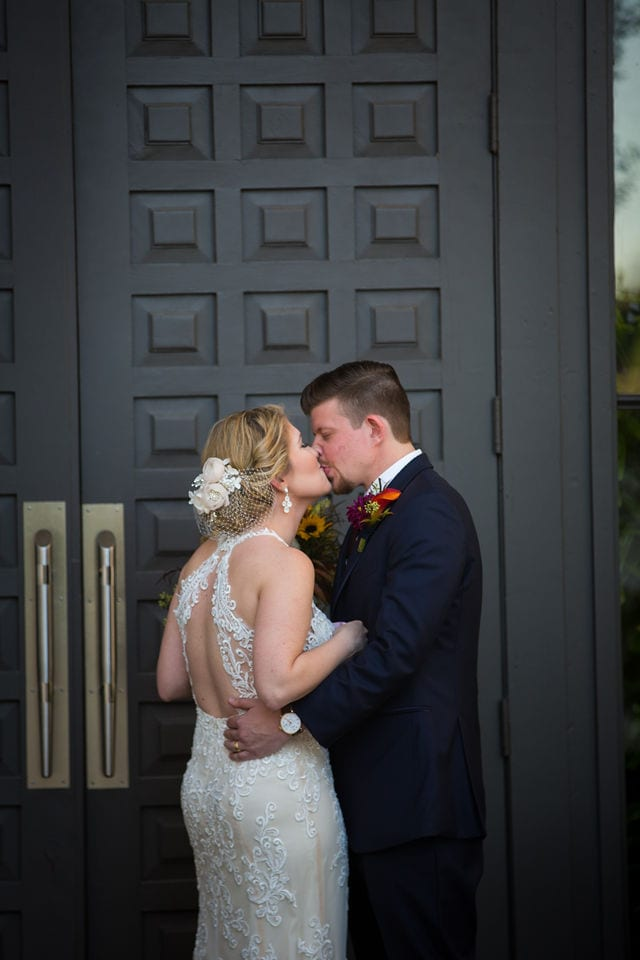 Ft Worth wedding kiss gray door Stonegate Mansion