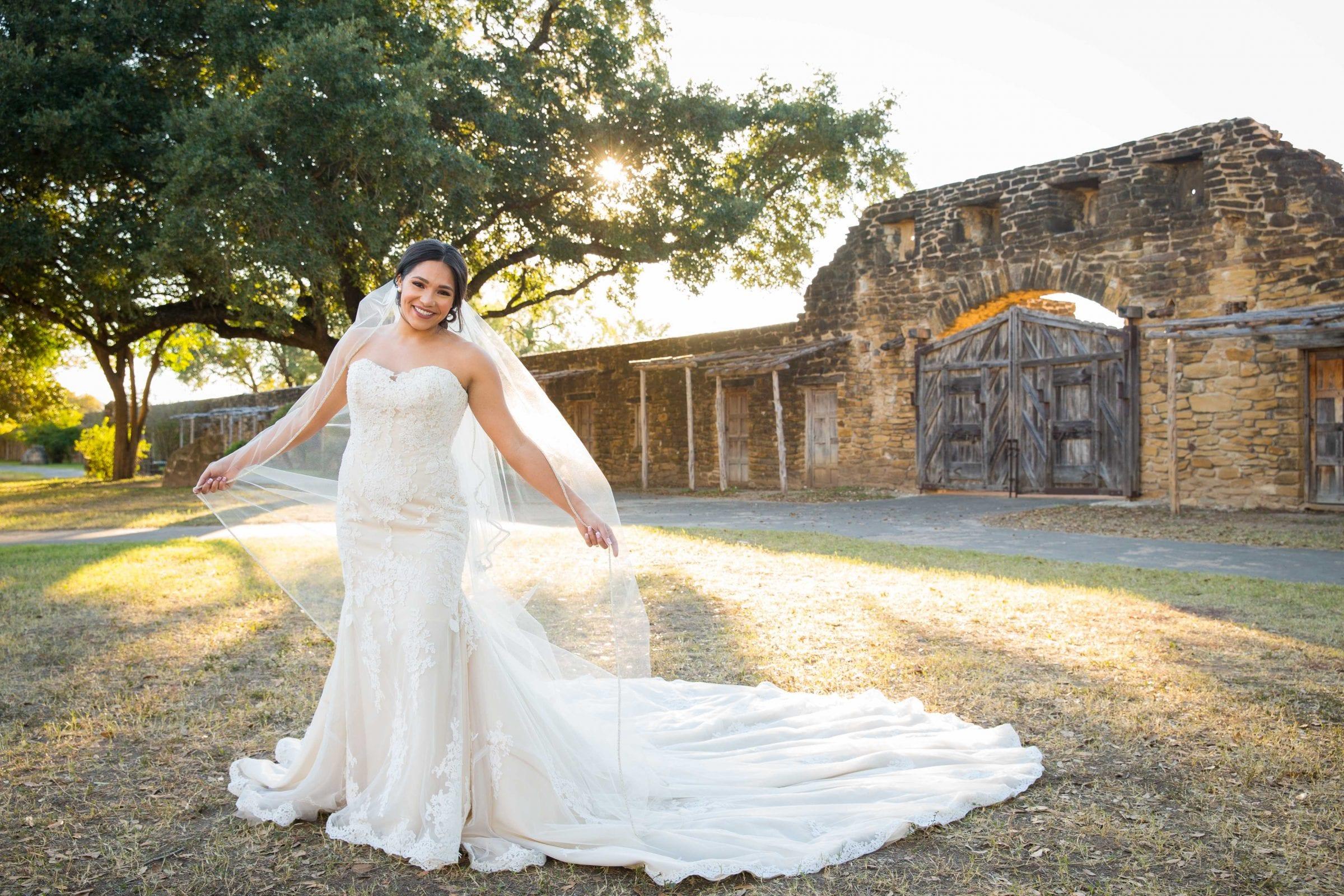 Kristen H Bridal holding veil Mission San Jose