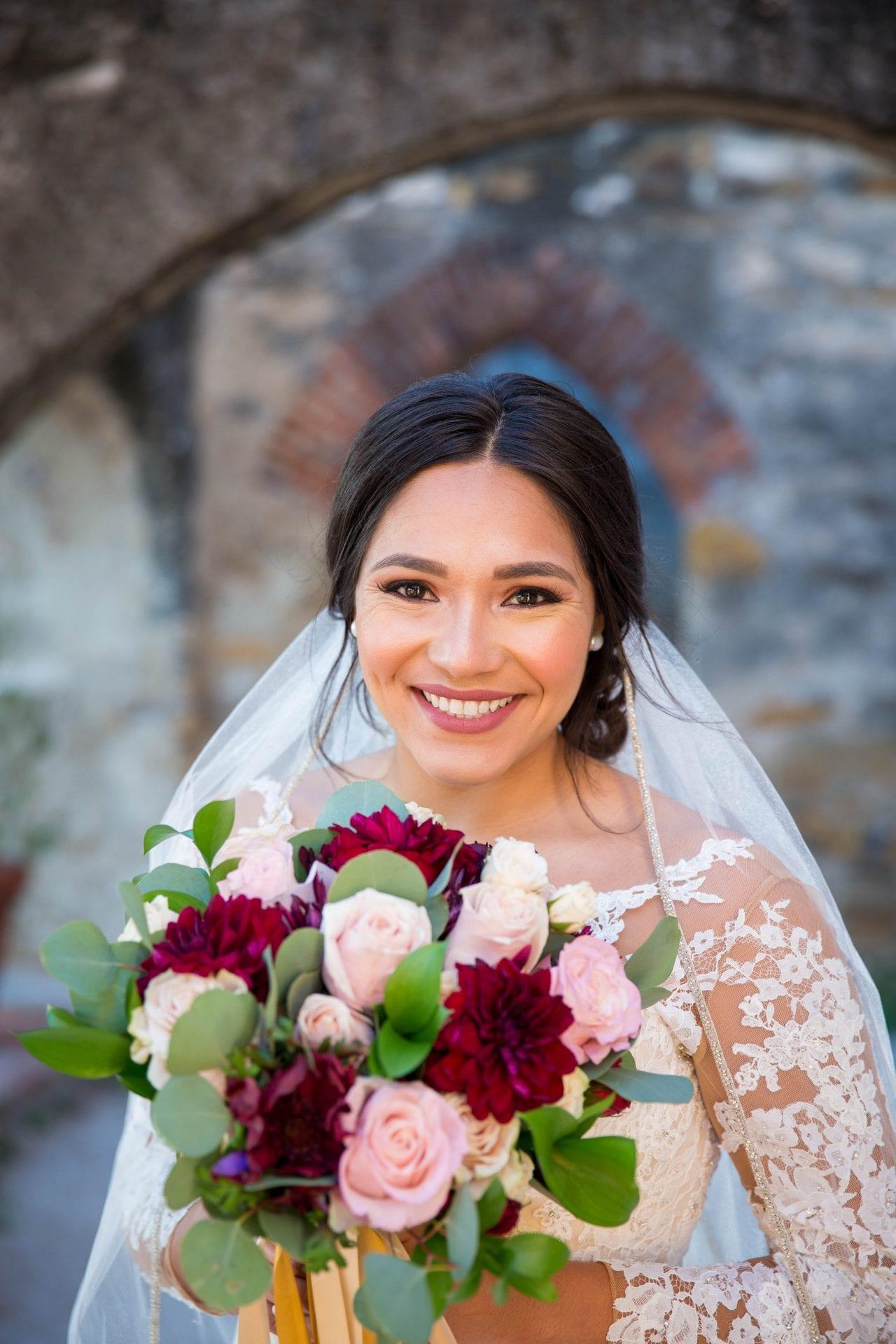 Kristen H Bridal holding flowers Mission San Jose