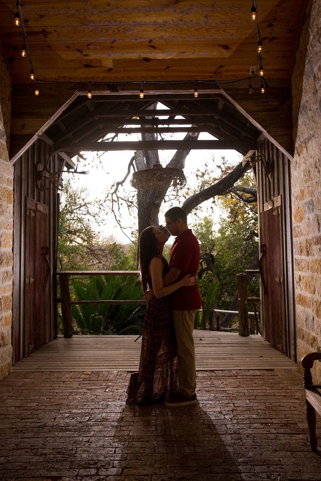 Aamber and Alex engagement session in Gruene Tx breezeway silhouette