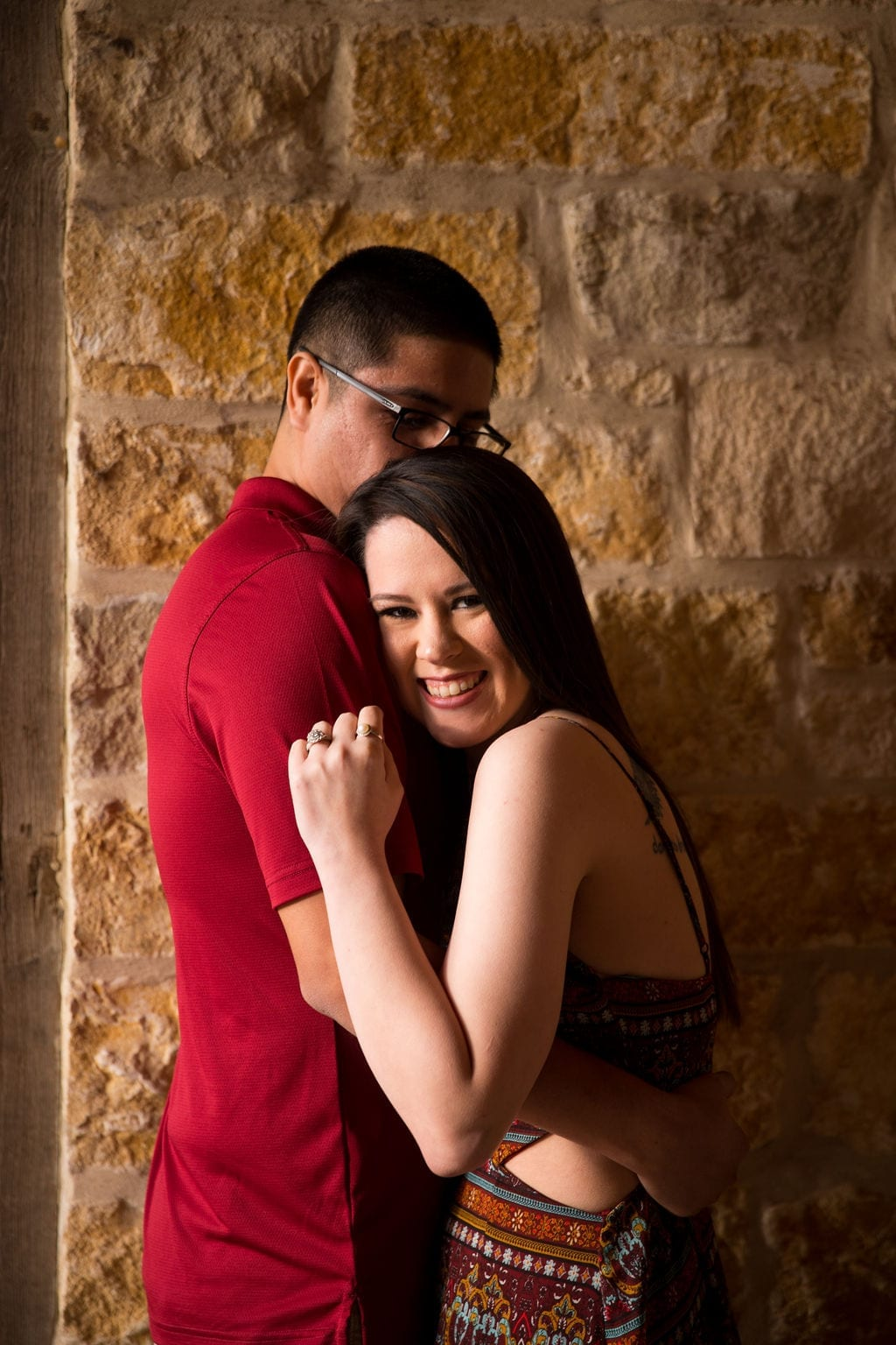 Aamber and Alex engagement session in Gruene Tx breezeway warm light