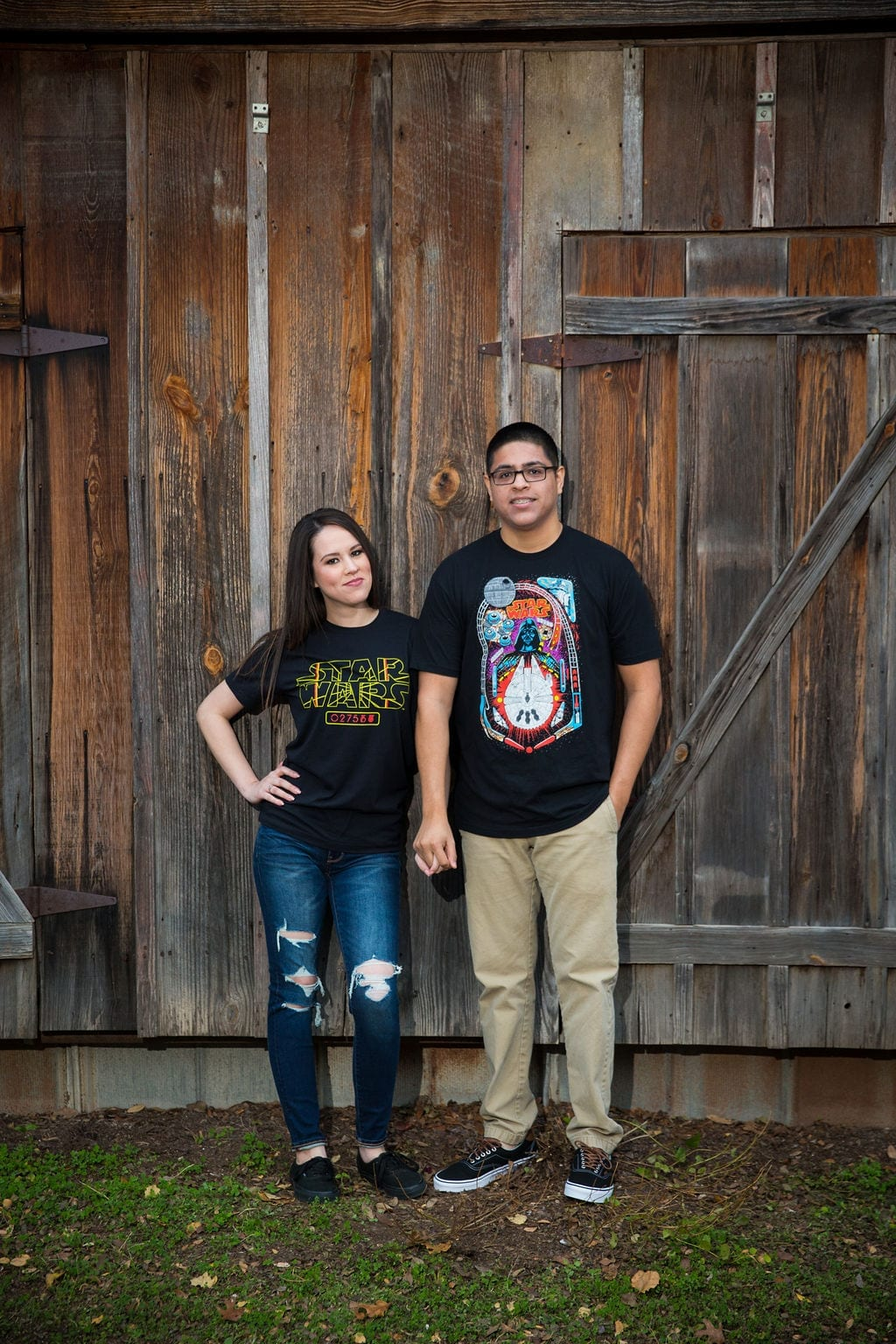 Aamber and Alex engagement session in Gruene Tx wood wall tee shirt