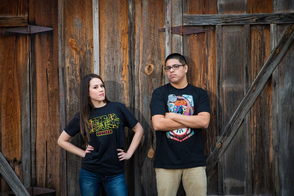 Aamber and Alex engagement session in Gruene Tx wood wall tee shirt attitude