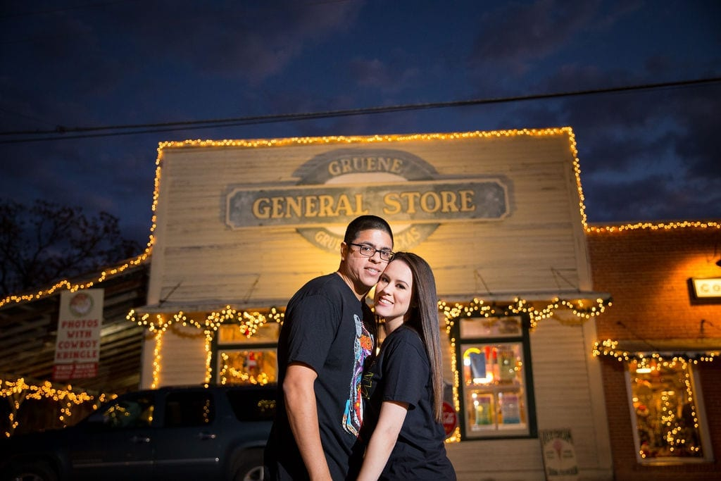 Aamber and Alex engagement session in Gruene Tx general store outside