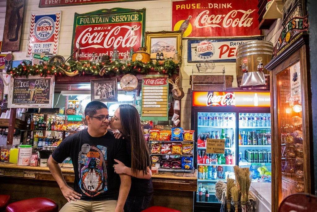 Aamber and Alex engagement session in Gruene Tx counter at store