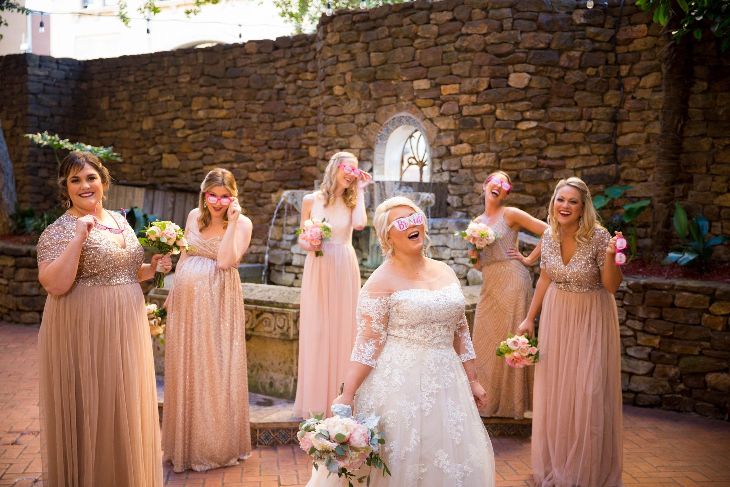Crawford wedding Omni Del Mansion riverwalk bridesmaids laughing