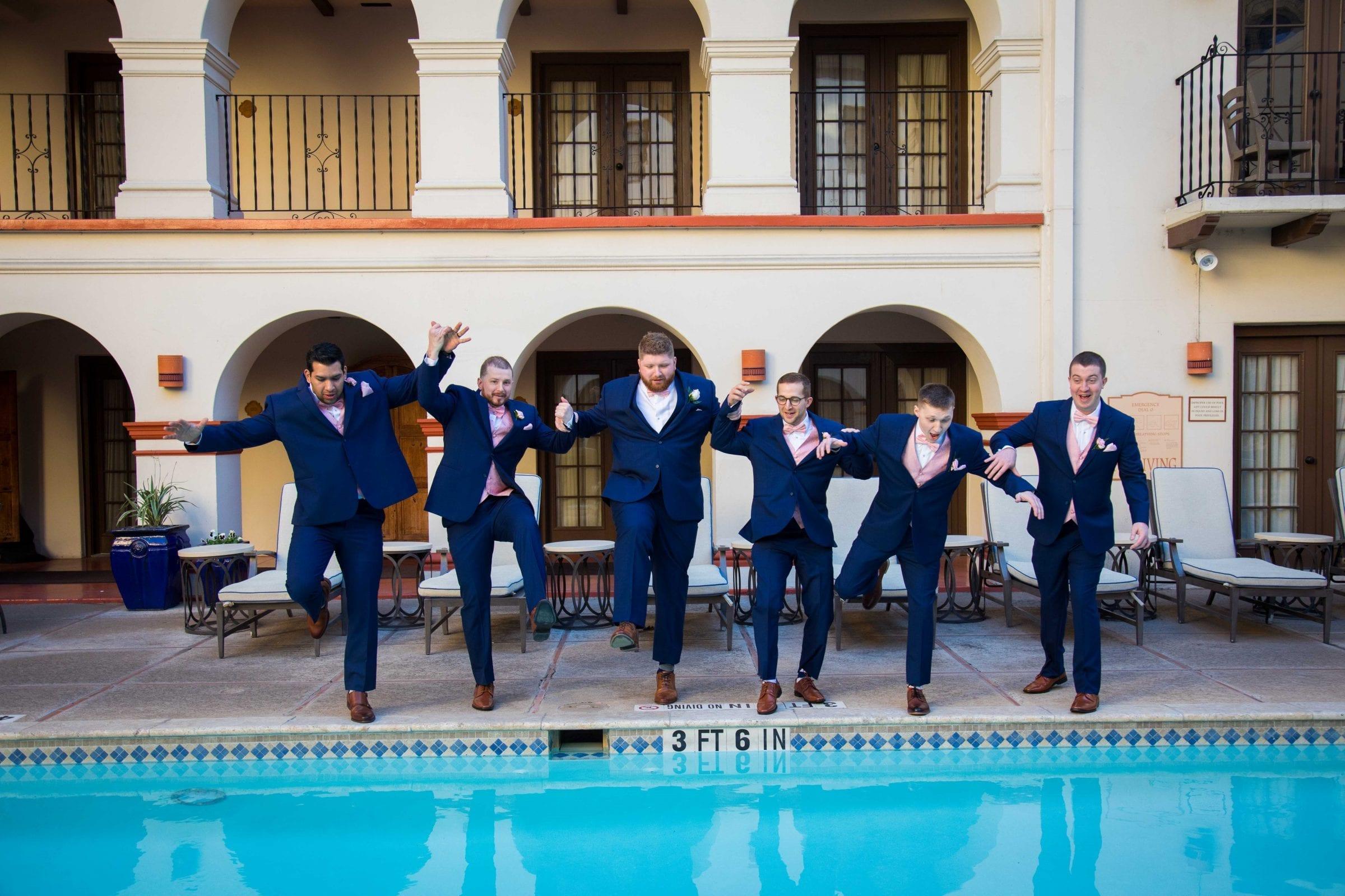 Crawford wedding Omni Del Mansion riverwalk groomsmen in pool