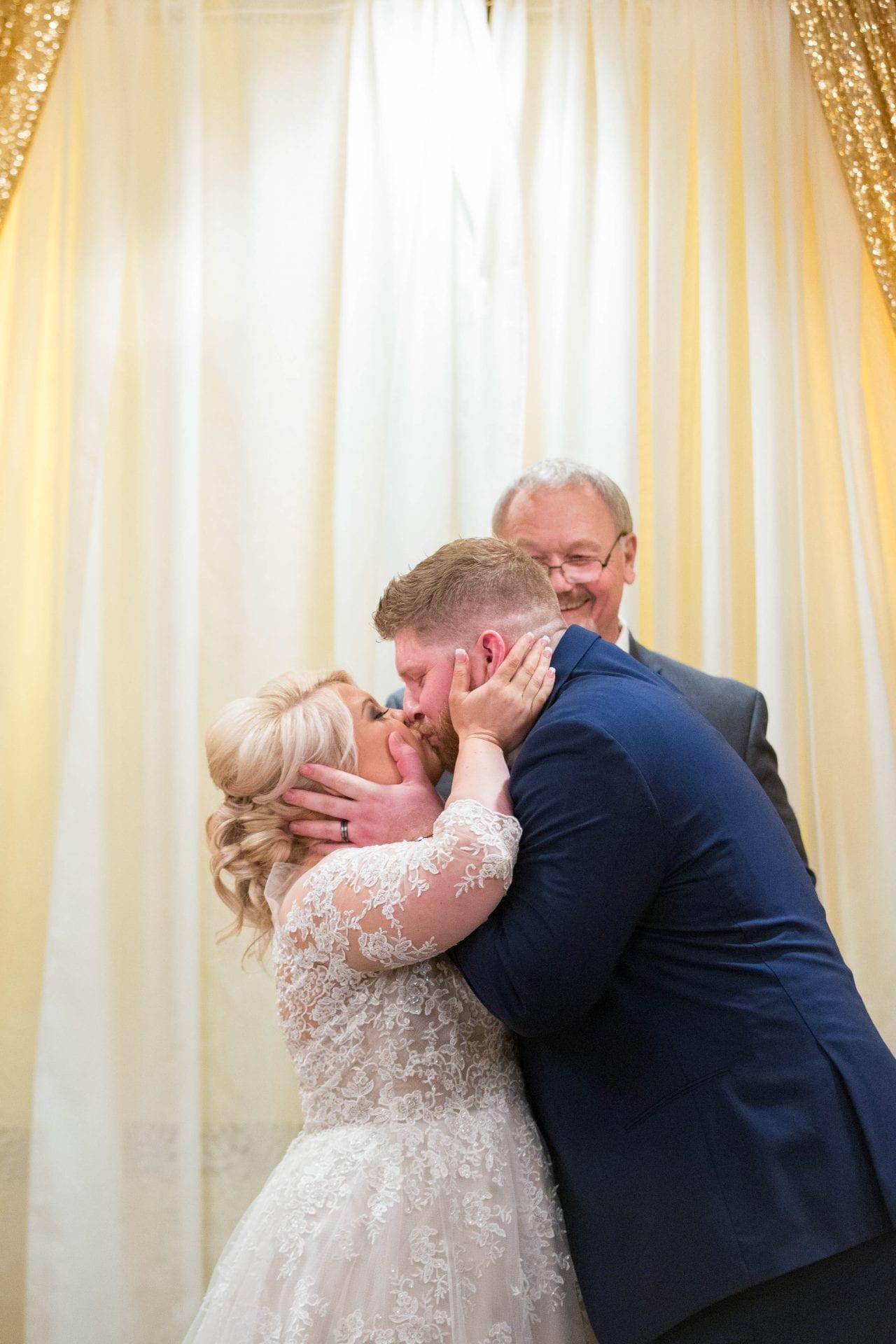 Crawford wedding Omni Del Mansion riverwalk wedding kiss