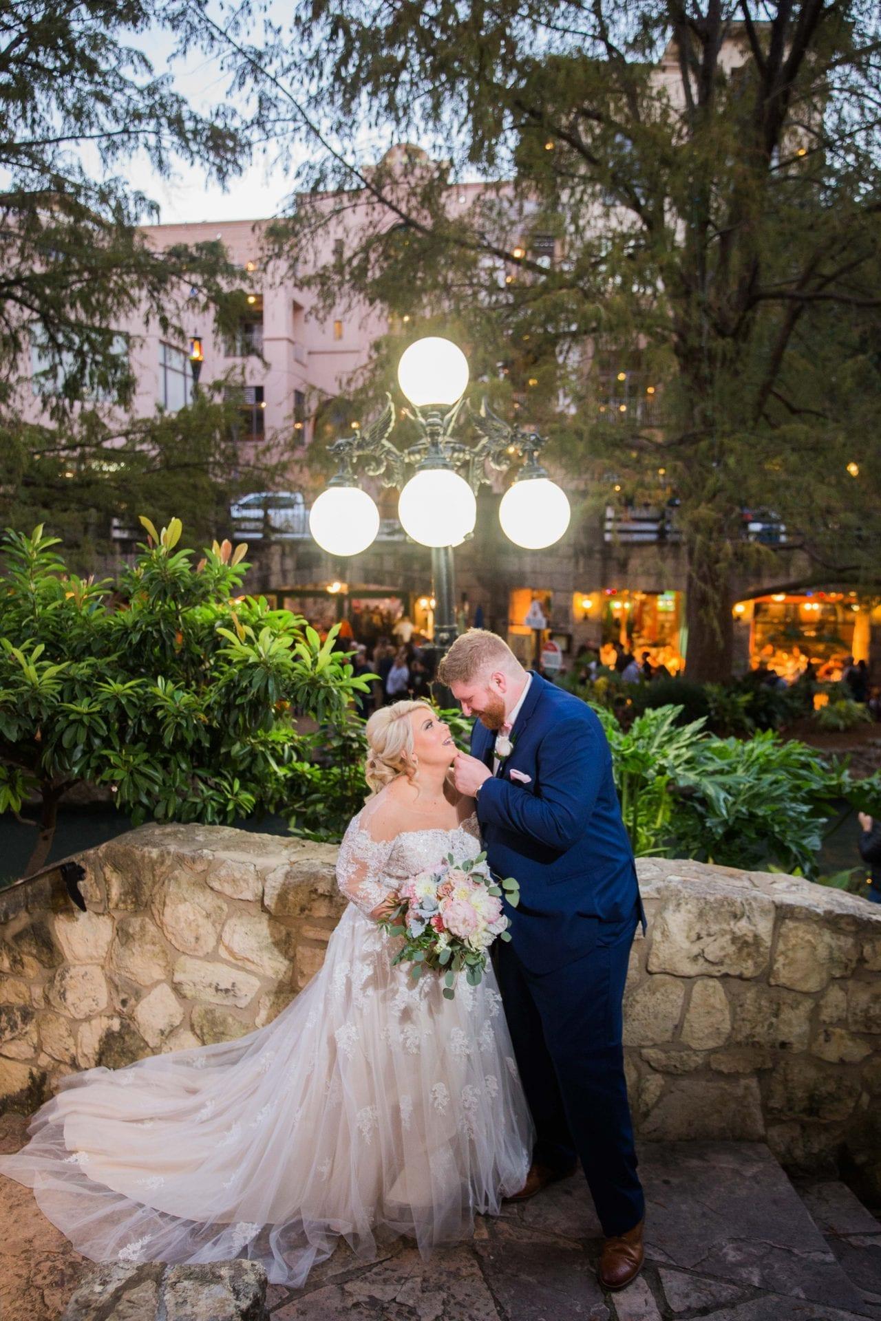Crawford wedding Omni Del Mansion riverwalk portrait under light