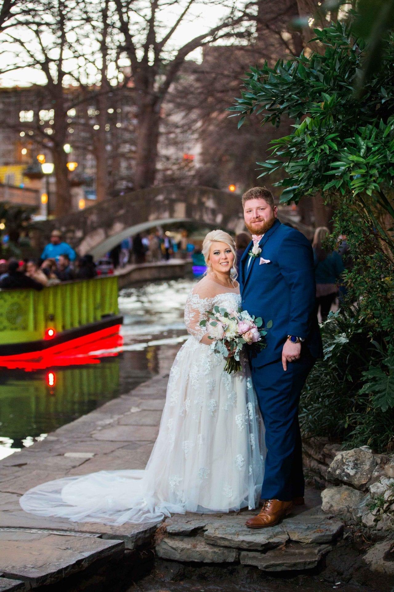 Crawford wedding Omni Del Mansion riverwalk portrait with boat