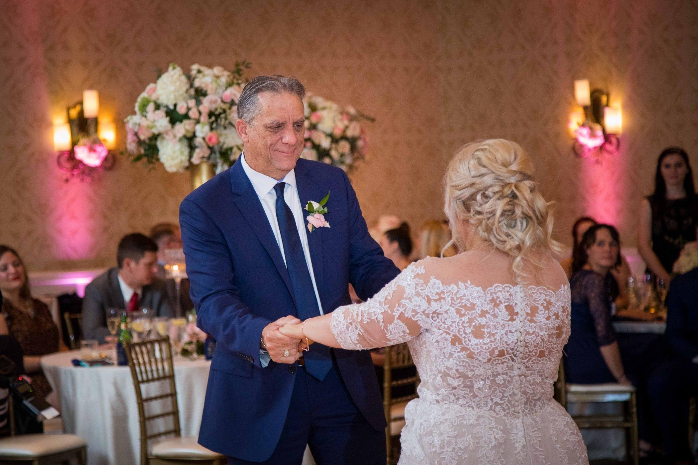 Crawford wedding Omni Del Mansion riverwalk dads dance swinging