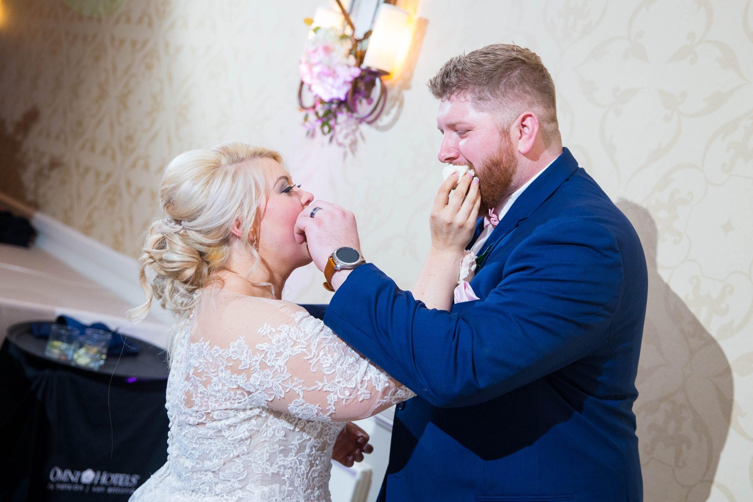 Crawford wedding Omni Del Mansion riverwalk cake feeding