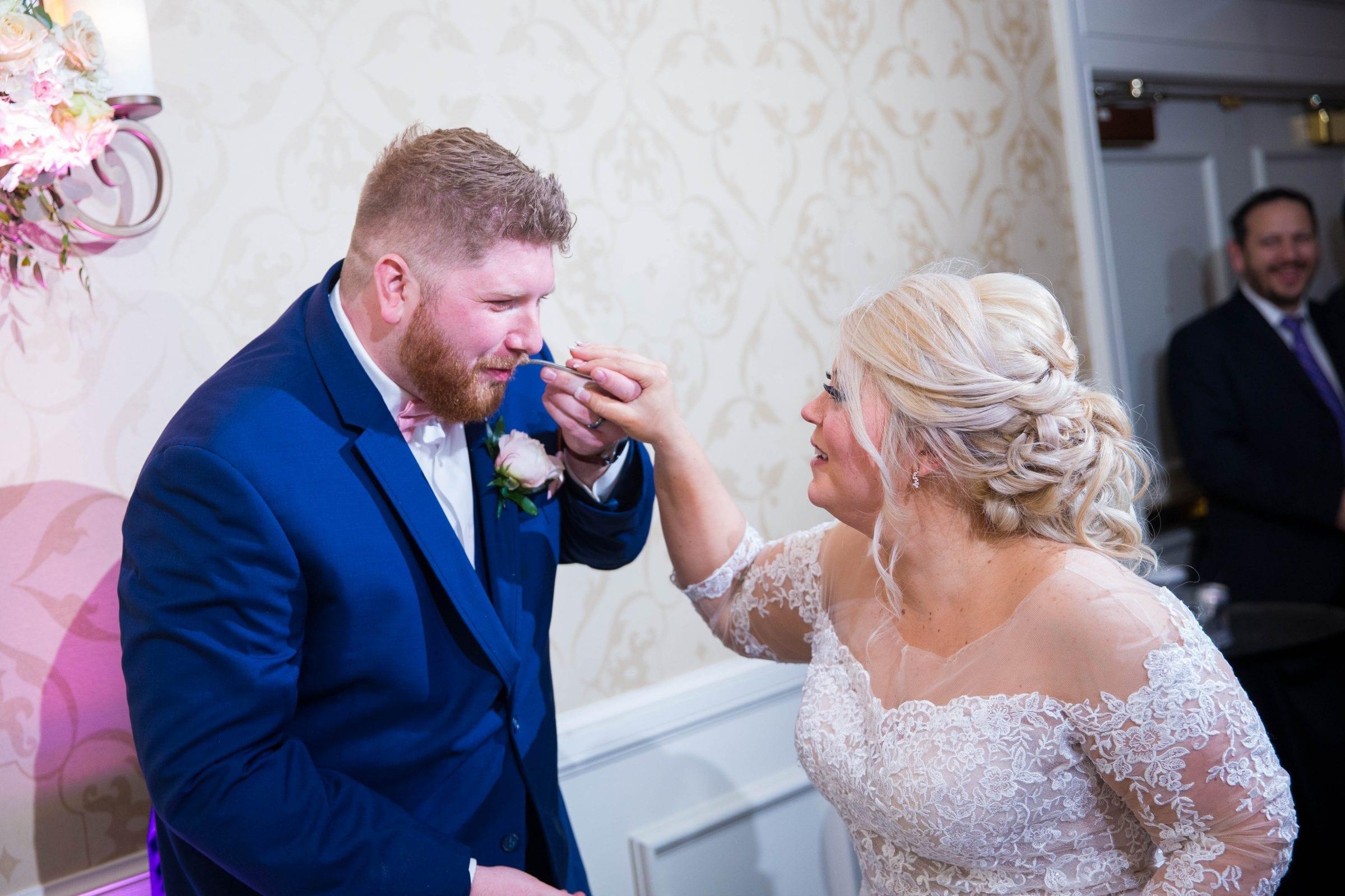Crawford wedding Omni Del Mansion riverwalk grooms cake feeding