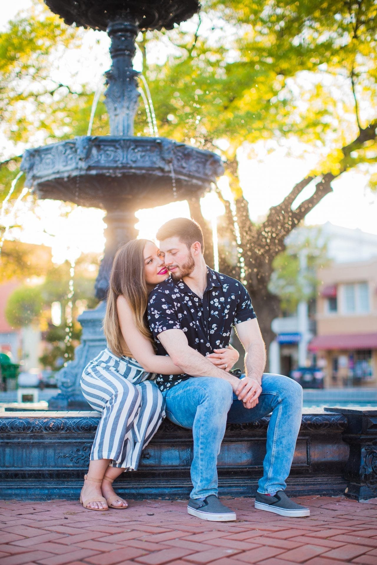 Liz and Ruben engagement at the fountain downtown New Braunfels