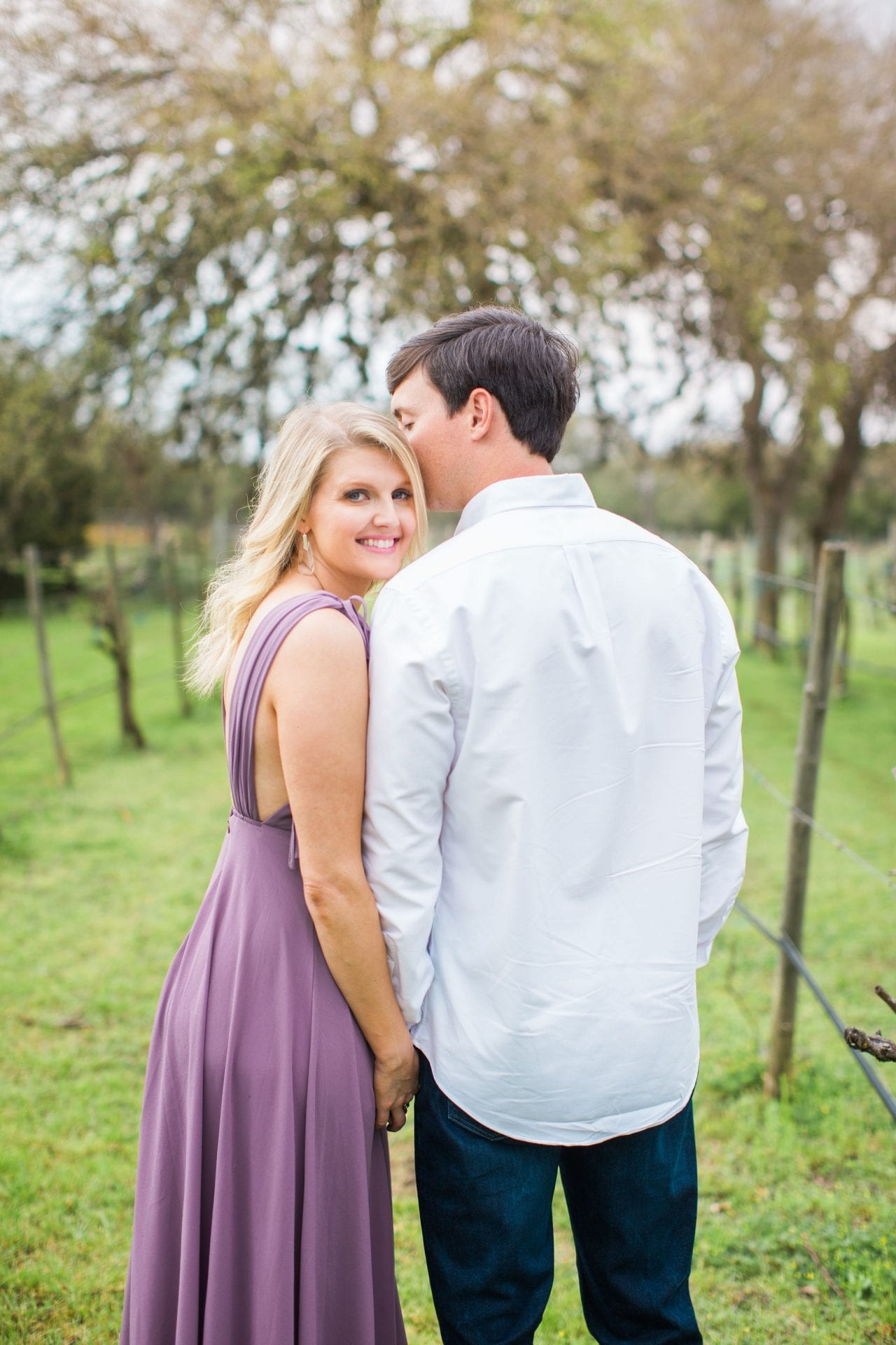 Michele Engagement session at Oak Valley Vineyards looking back purple dress