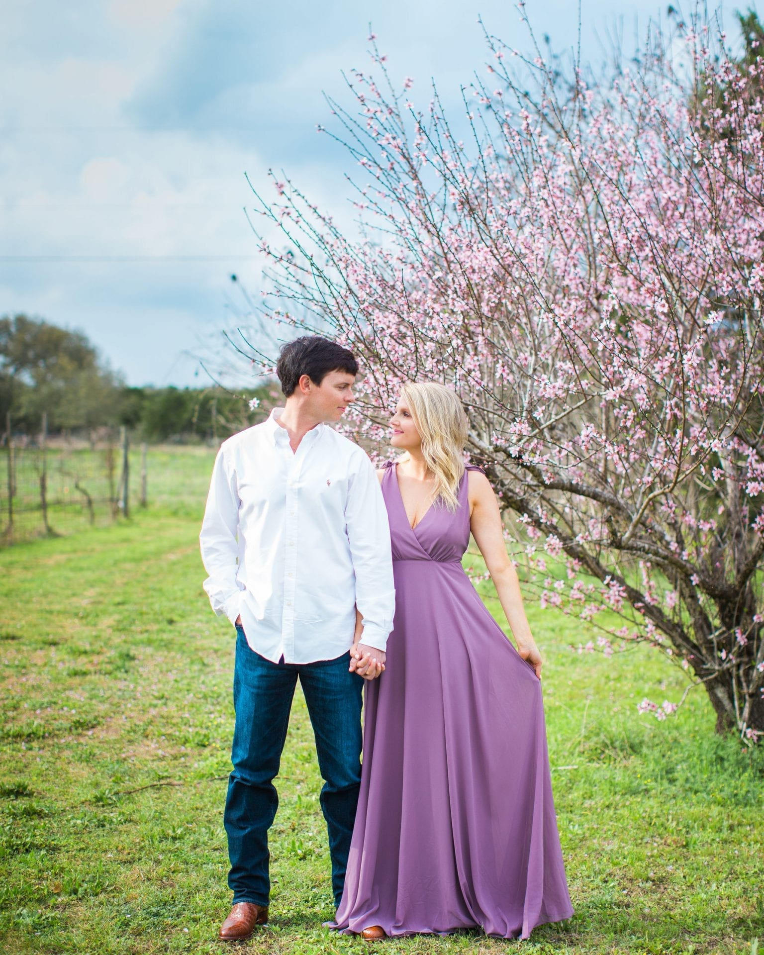 Michele Engagement session at Oak Valley Vineyards in front of pink flowers