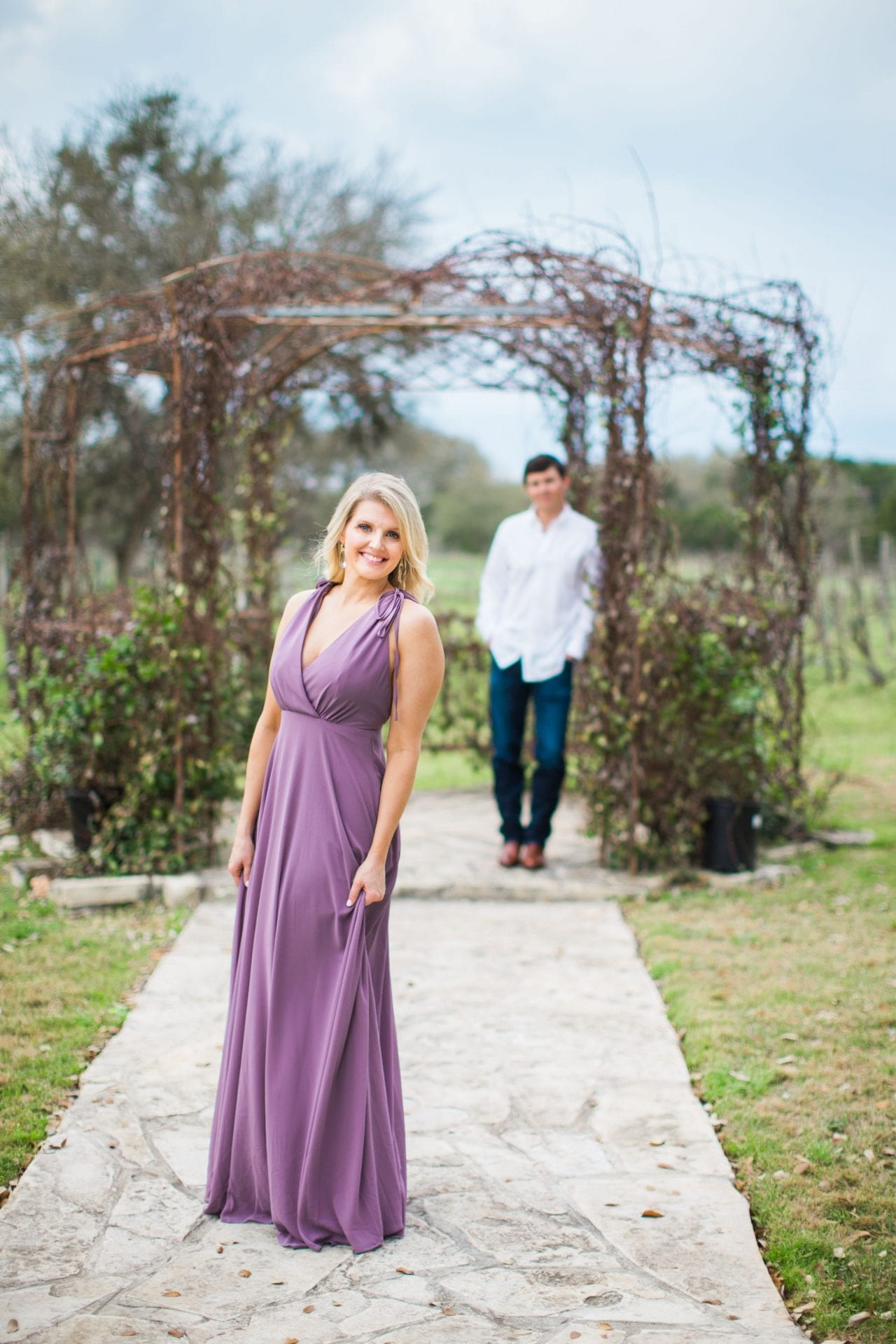 Michele Engagement session at Oak Valley Vineyards by gazebo her in front