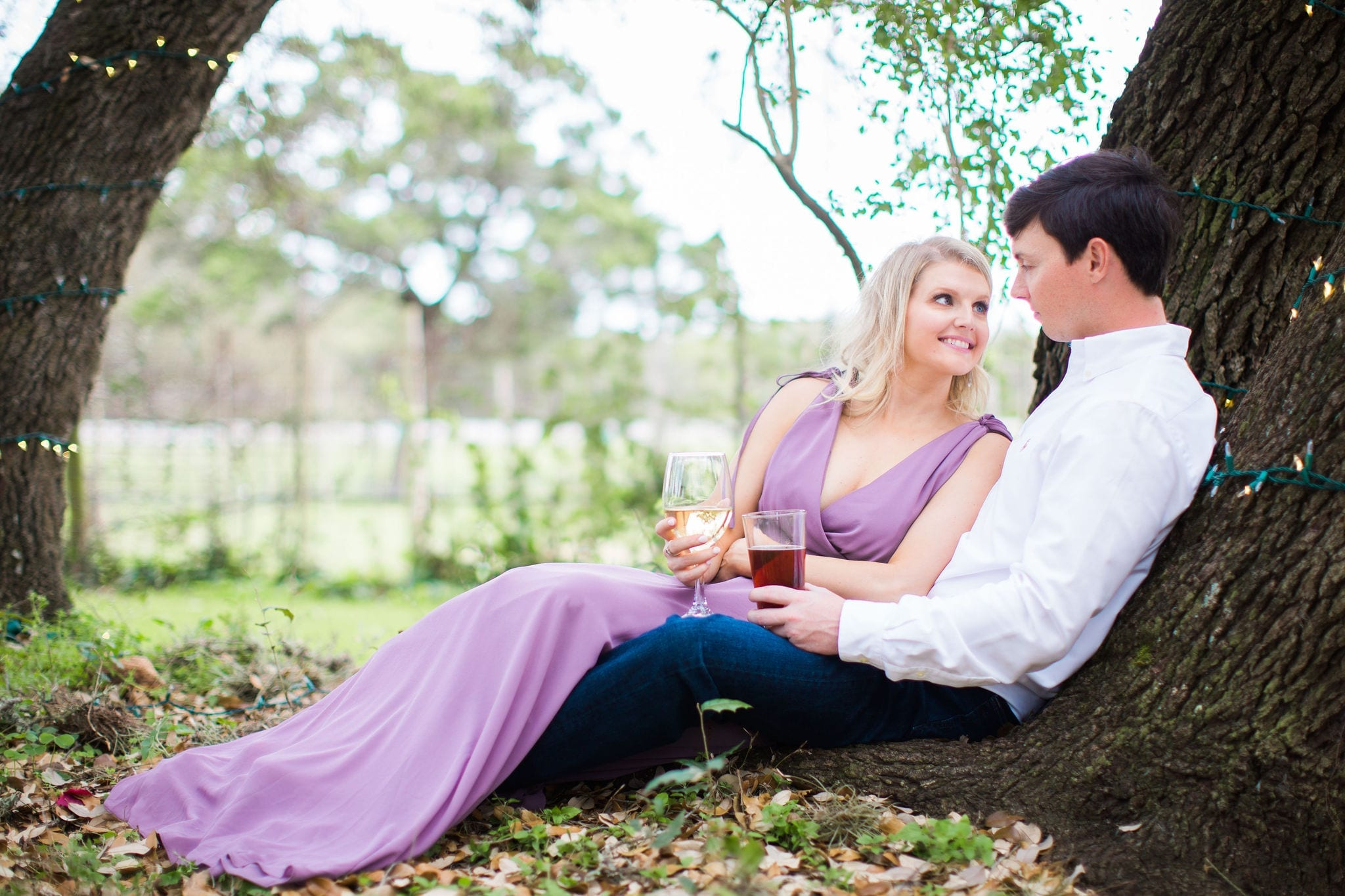 Michele Engagement session at Oak Valley Vineyards sitting in trees drinking wine