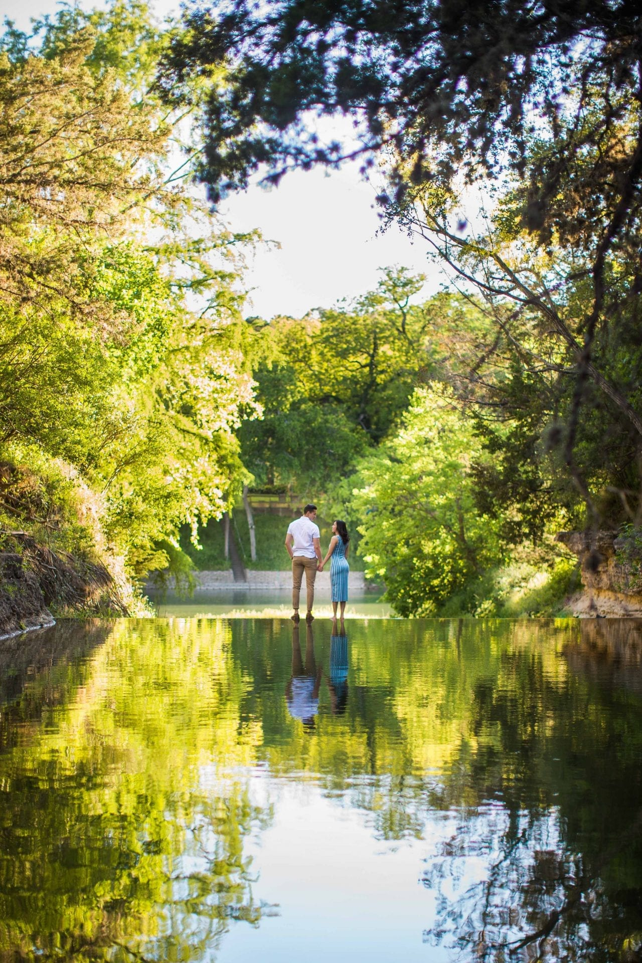Jennifer and Nhon engagement New Braunfels floating on dam