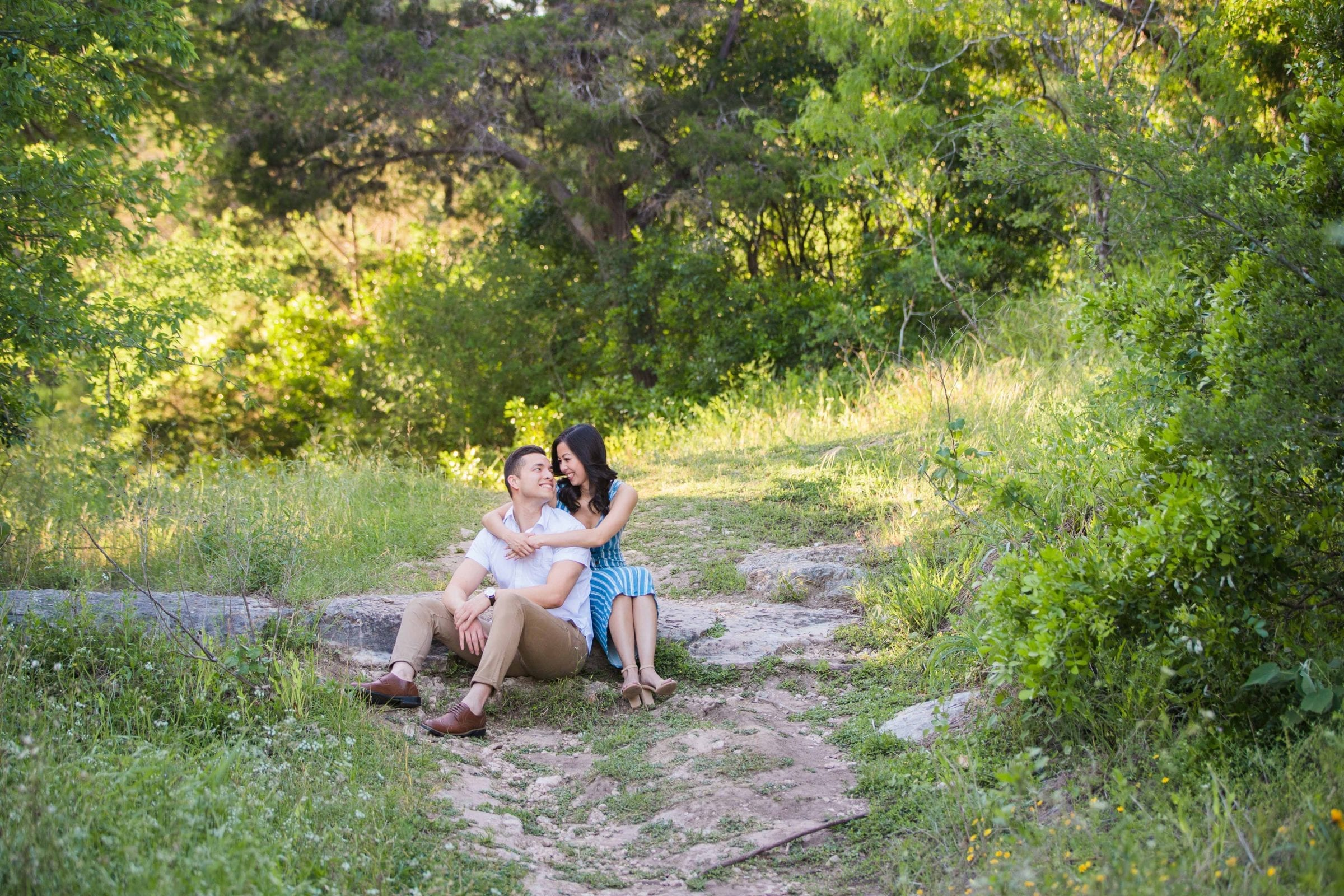 Jennifer and Nhon engagement New Braunfels sitting on path