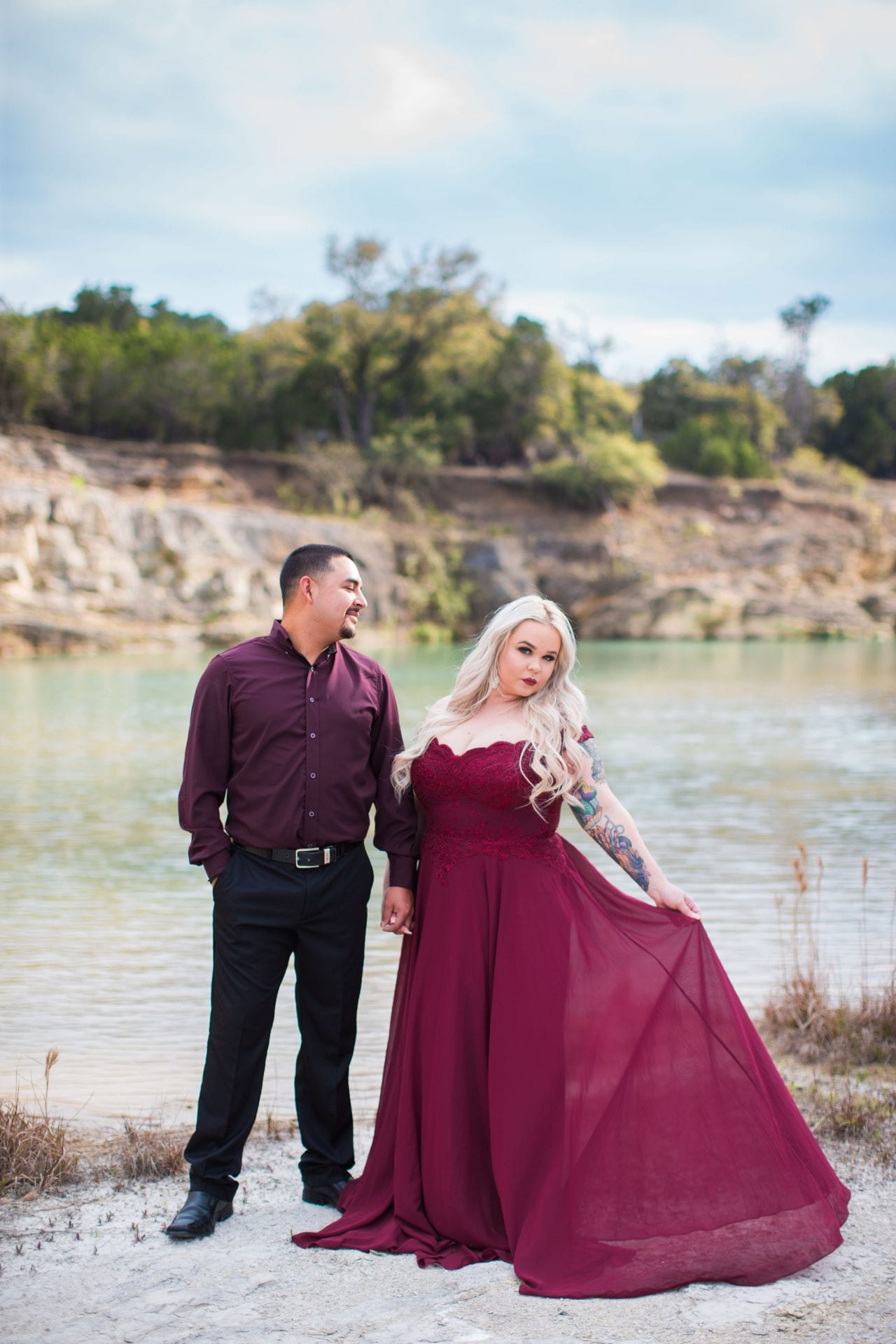 Katie and Gabe engagement session Canyon Lake dam gorge on the island looking at dress