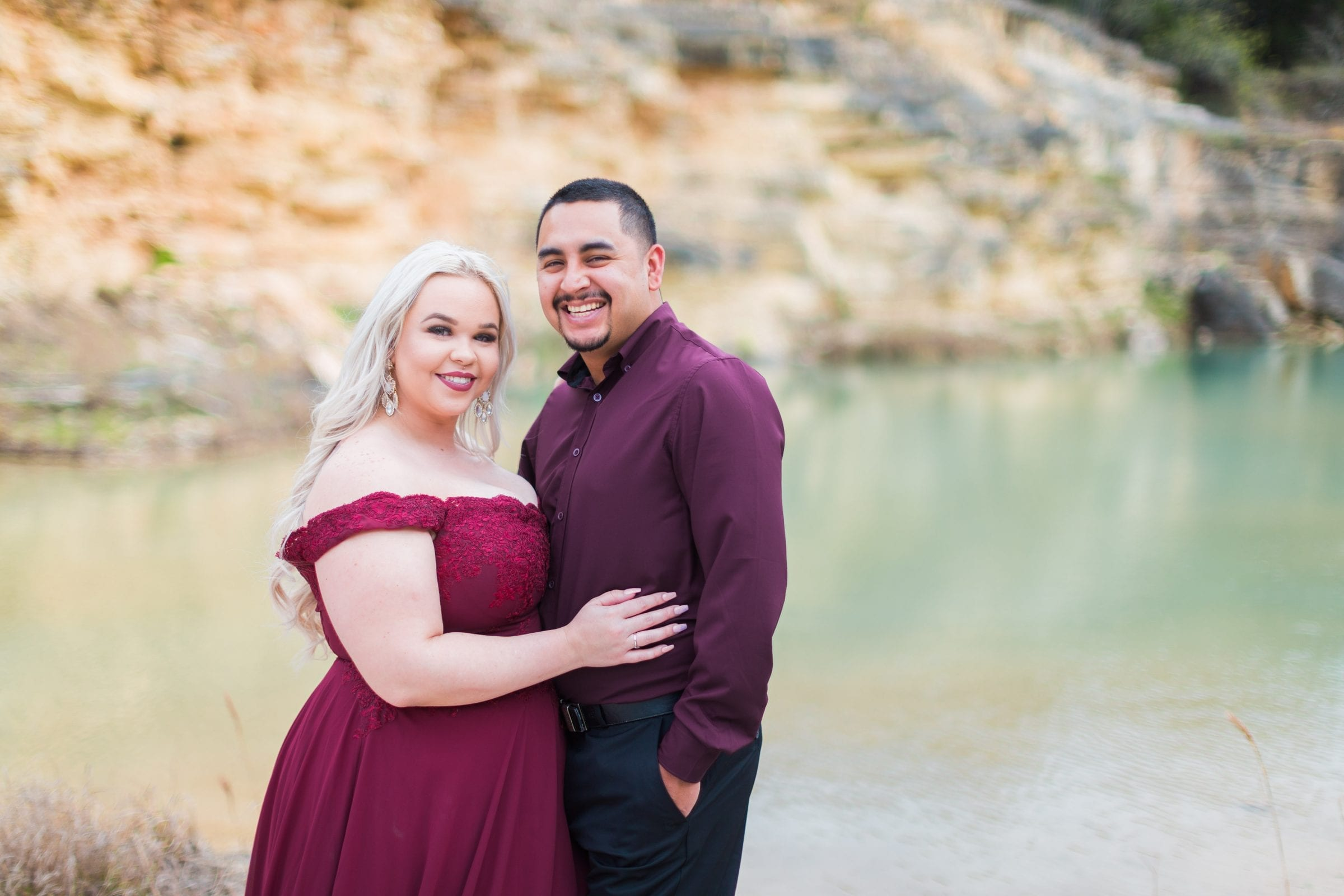 Katie and Gabe engagement session Canyon Lake dam gorge on the island yellow wall portrait