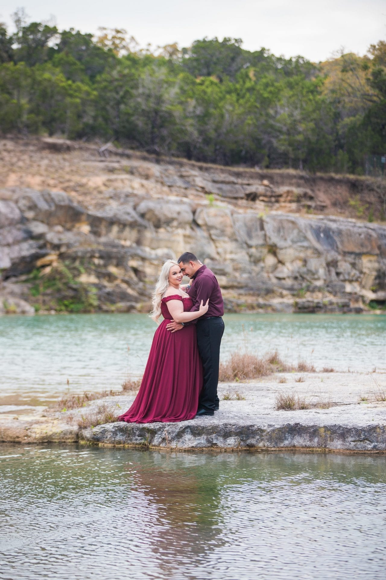 Katie and Gabe engagement session Canyon Lake dam gorge on the island looking at ea other close up