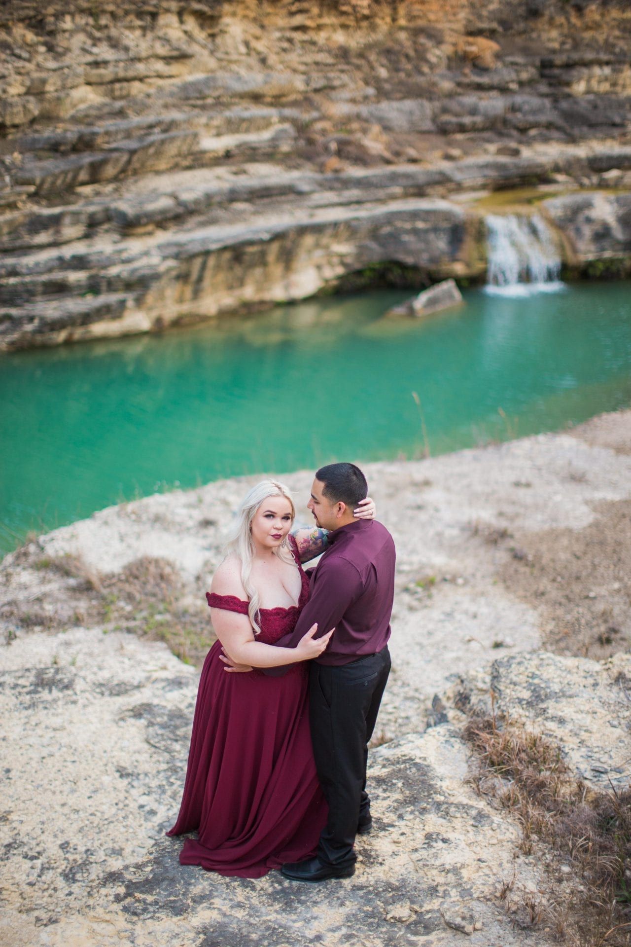 Katie and Gabe engagement session Canyon Lake dam gorge on rocks looking up
