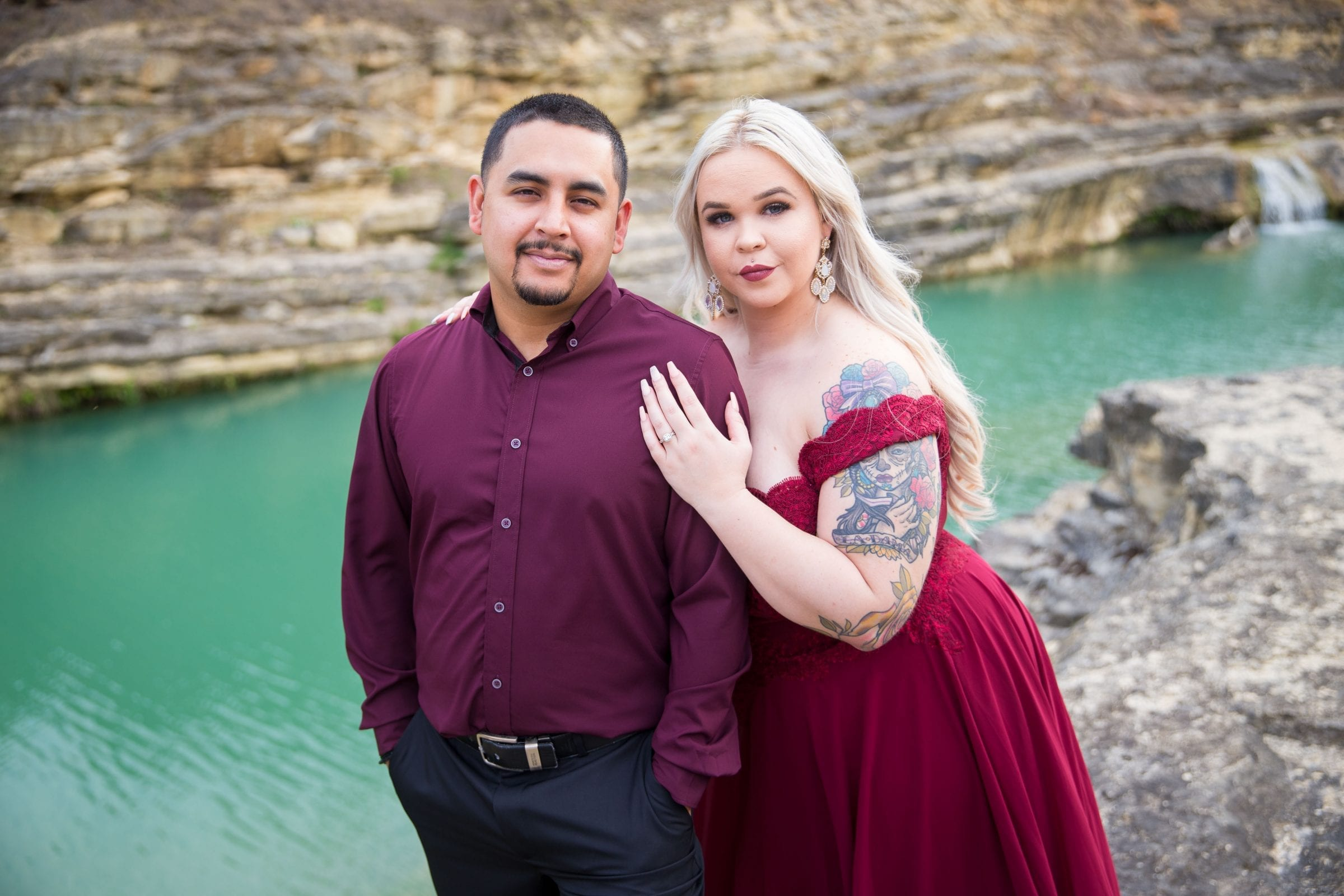 Katie and Gabe engagement session Canyon Lake dam gorge on rocks portrait