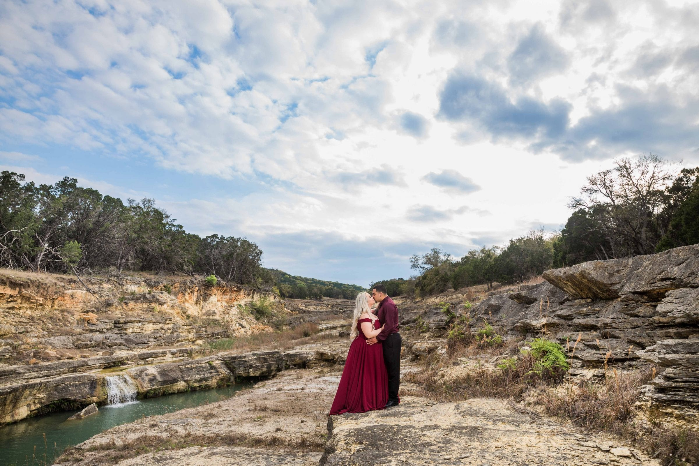 Katie and Gabe engagement session Canyon Lake dam gorge on rocks full sky