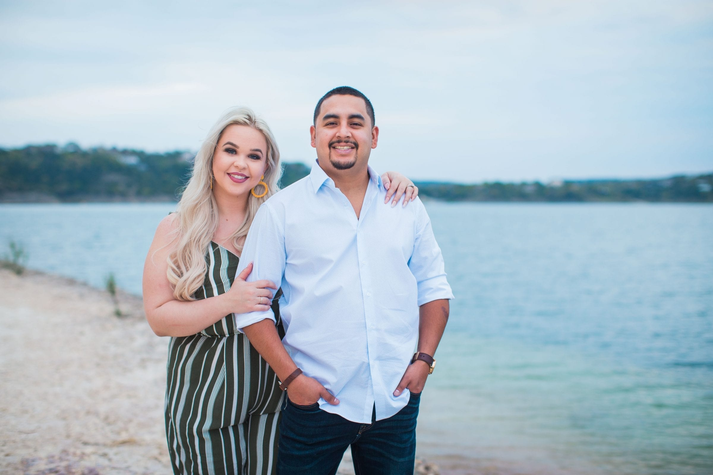 Katie & Gabe engagement session Canyon Lake dam on the water portrait
