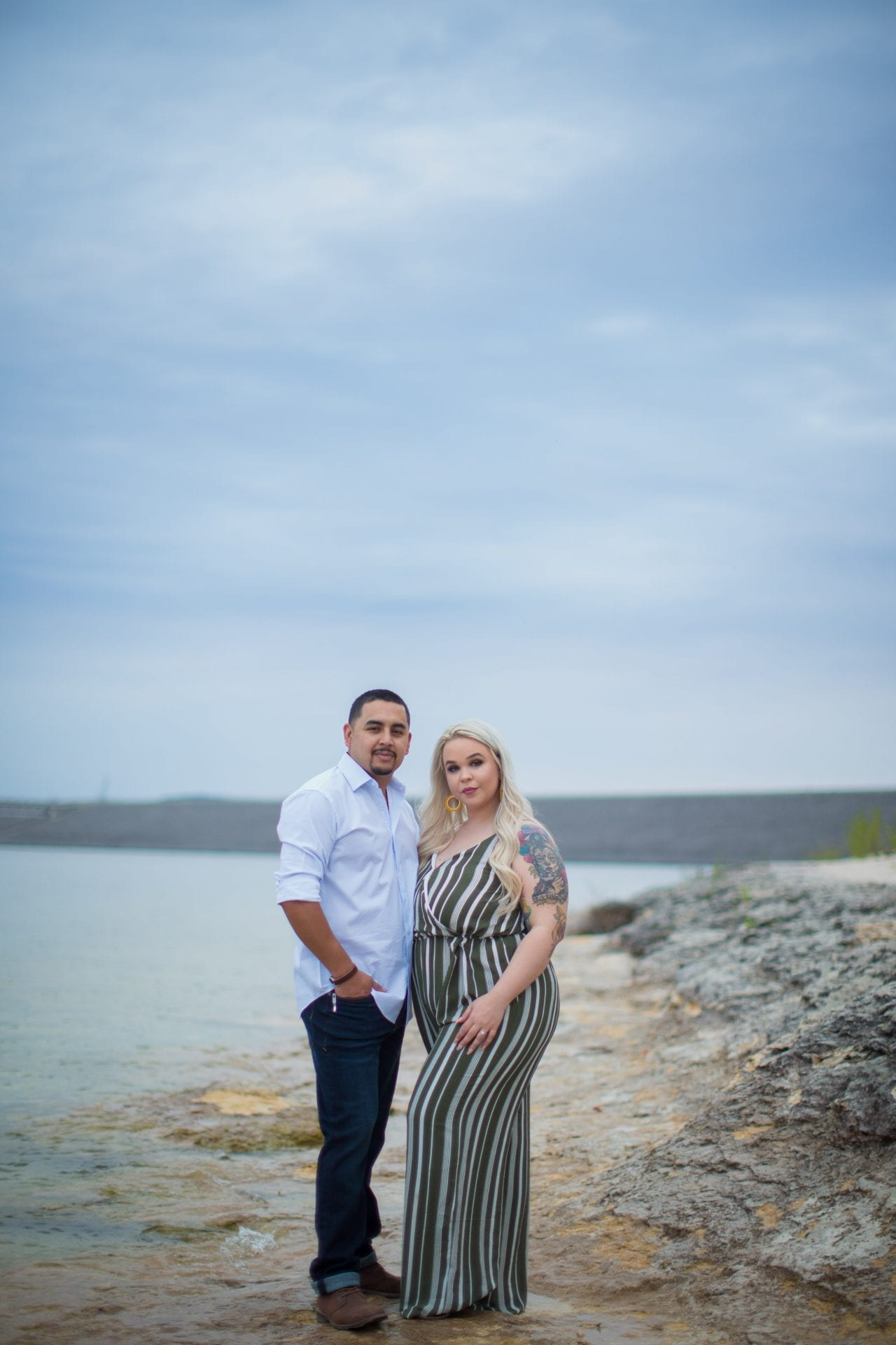 Katie & Gabe engagement session Canyon Lake dam behind on the water portrait