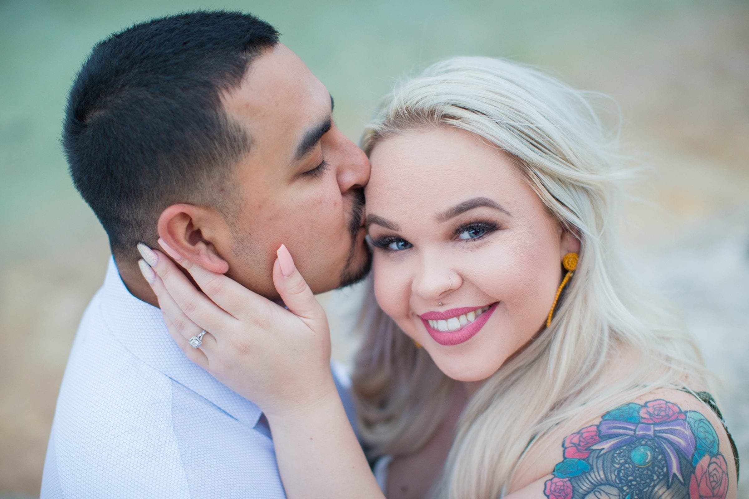 Katie & Gabe engagement session Canyon Lake dam on the water close up Katie looking Gabe kissing