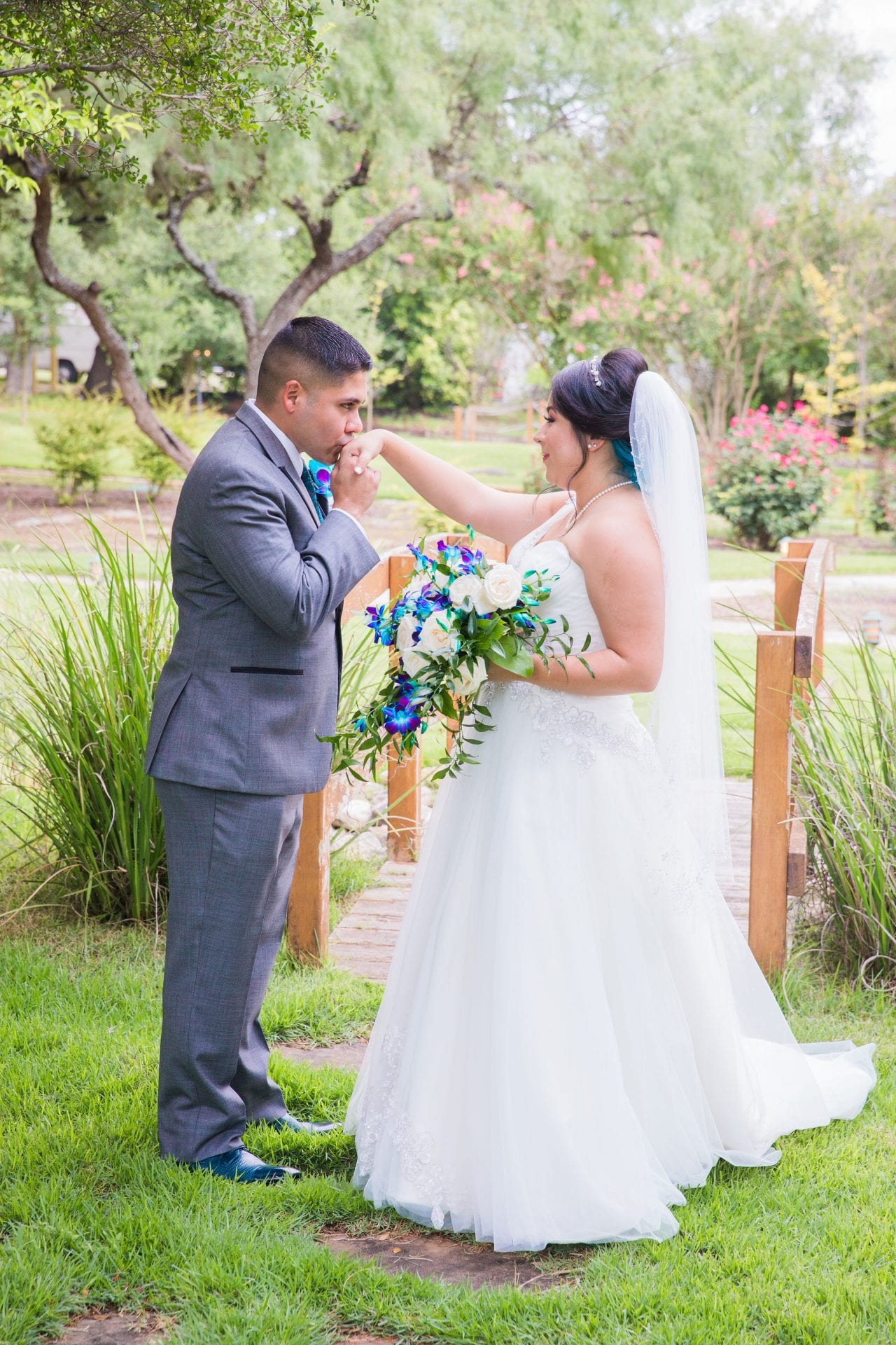 Alex and Adrien Wedding at The Gardens at Old Town hand kiss